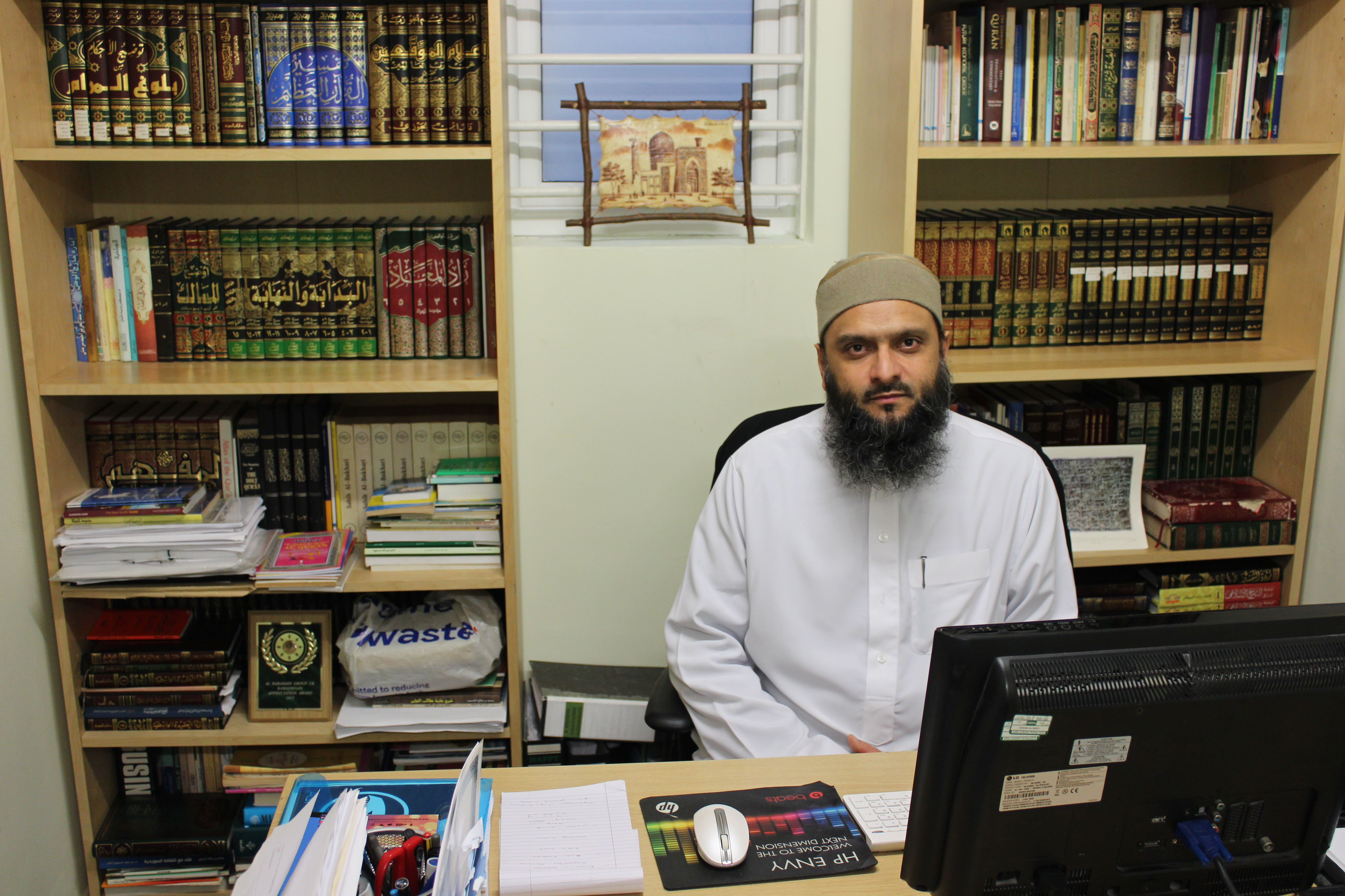 Under the spotlight. Shakeel Begg, the chief imam of the Lewisham Islamic Centre at his office.  (Mahmud el-Shafey)