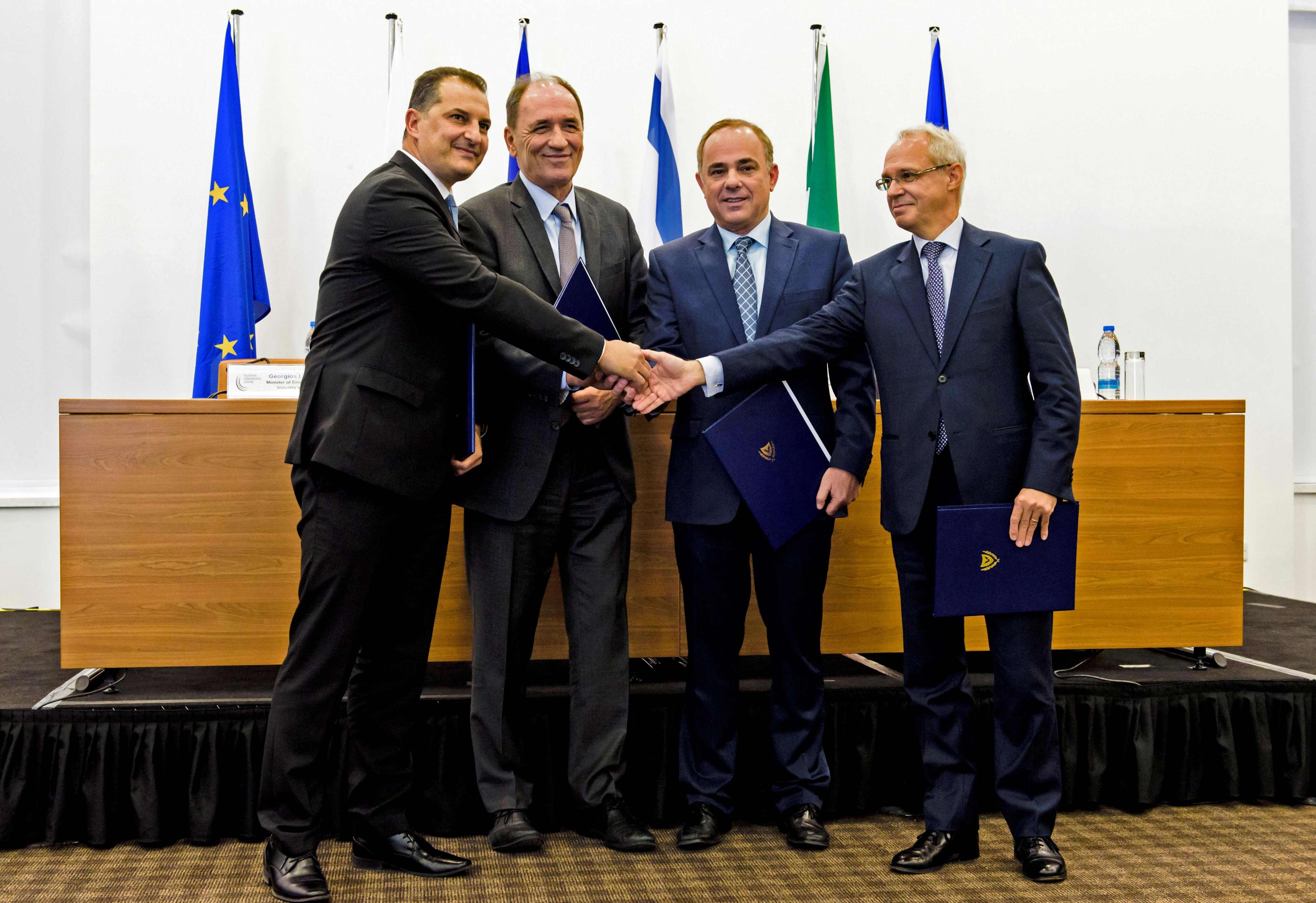 Grand ambitions. (From L-R) Cypriot Energy Minister Georgios Lakkotrypis, Greek Energy Minister Giorgos Stathakis, Israeli Energy Minister Yuval Steinitz and Ambassador of Italy in Cyprus Andrea Cavallari attend a meeting for the East Med Pipeline in Nicosia, last December.                                                                            (AFP)