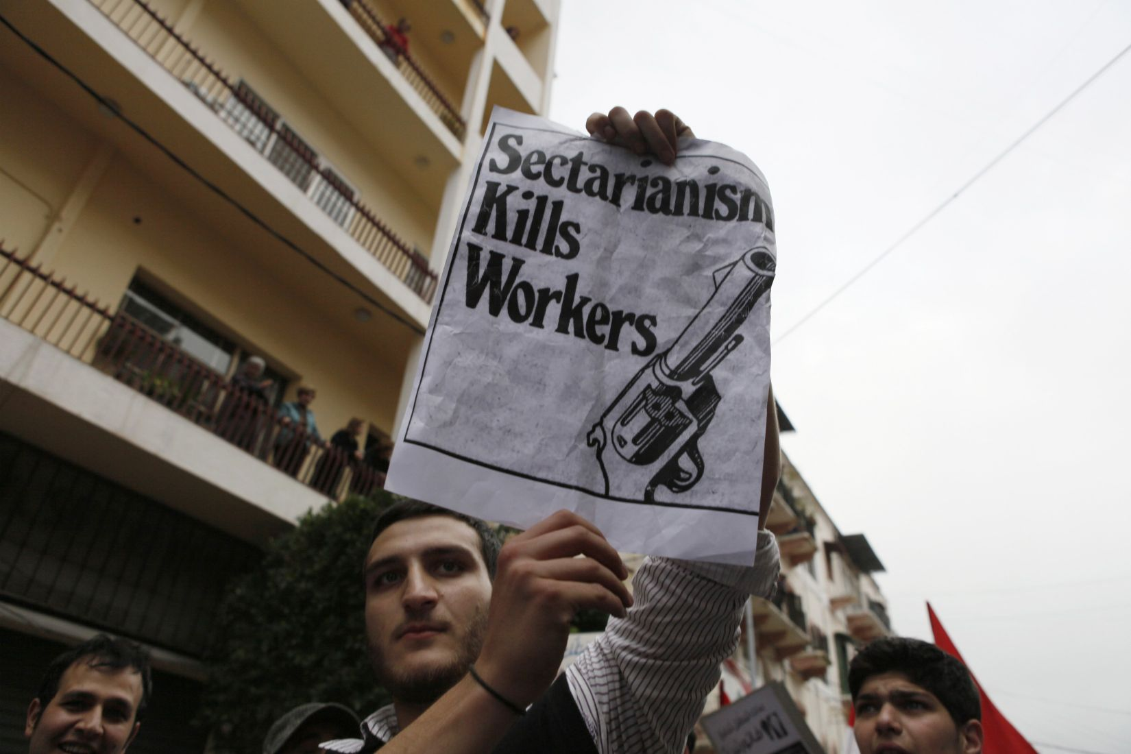 Delicate equation. A file picture shows a protester holding up a banner during a march against Lebanon's sectarian political system in Beirut. (Reuters)
