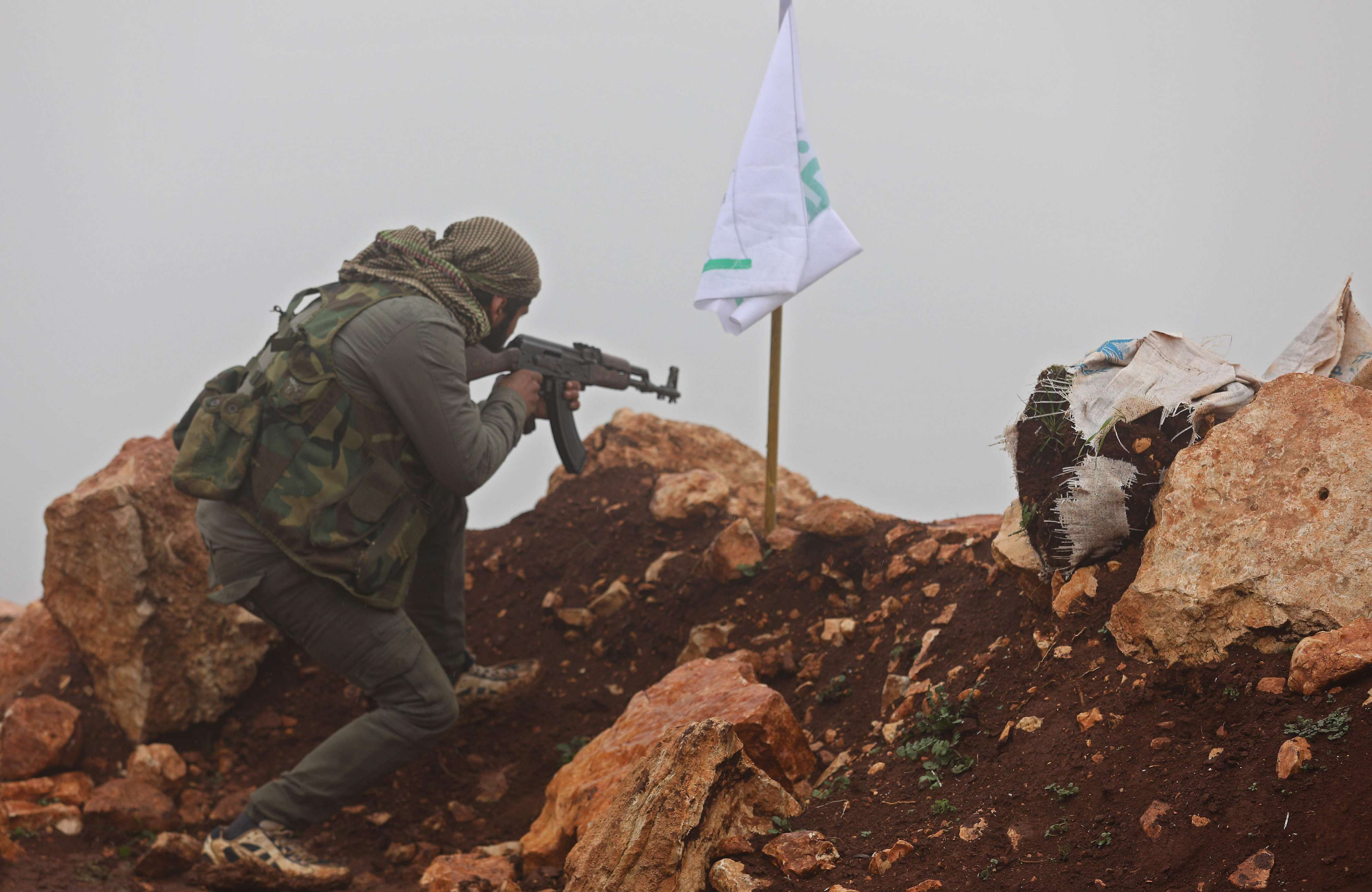 Imminent conundrum. A Turkey-backed Syrian rebel fighter mans a monitoring point near the Syrian village of Qilah on the south-western edge of the Afrin, on January 24. (AFP)