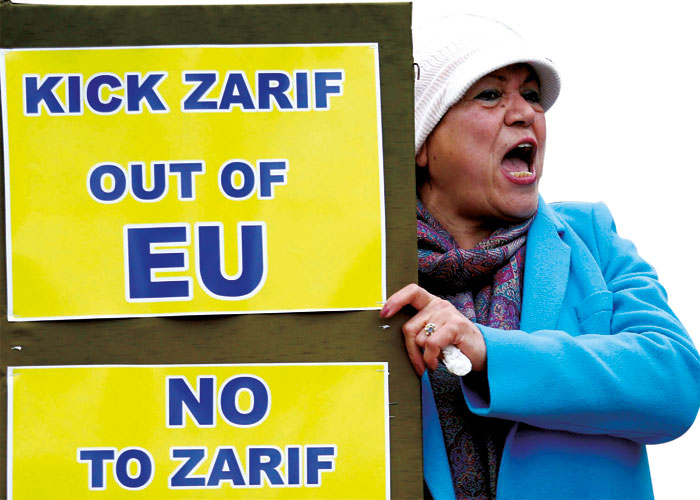 A woman chants slogans during a protest against the visit of Iran's Foreign Minister Mohammad Javad Zarif outside the European Union Council in Brussels, on January 10. (Reuters)