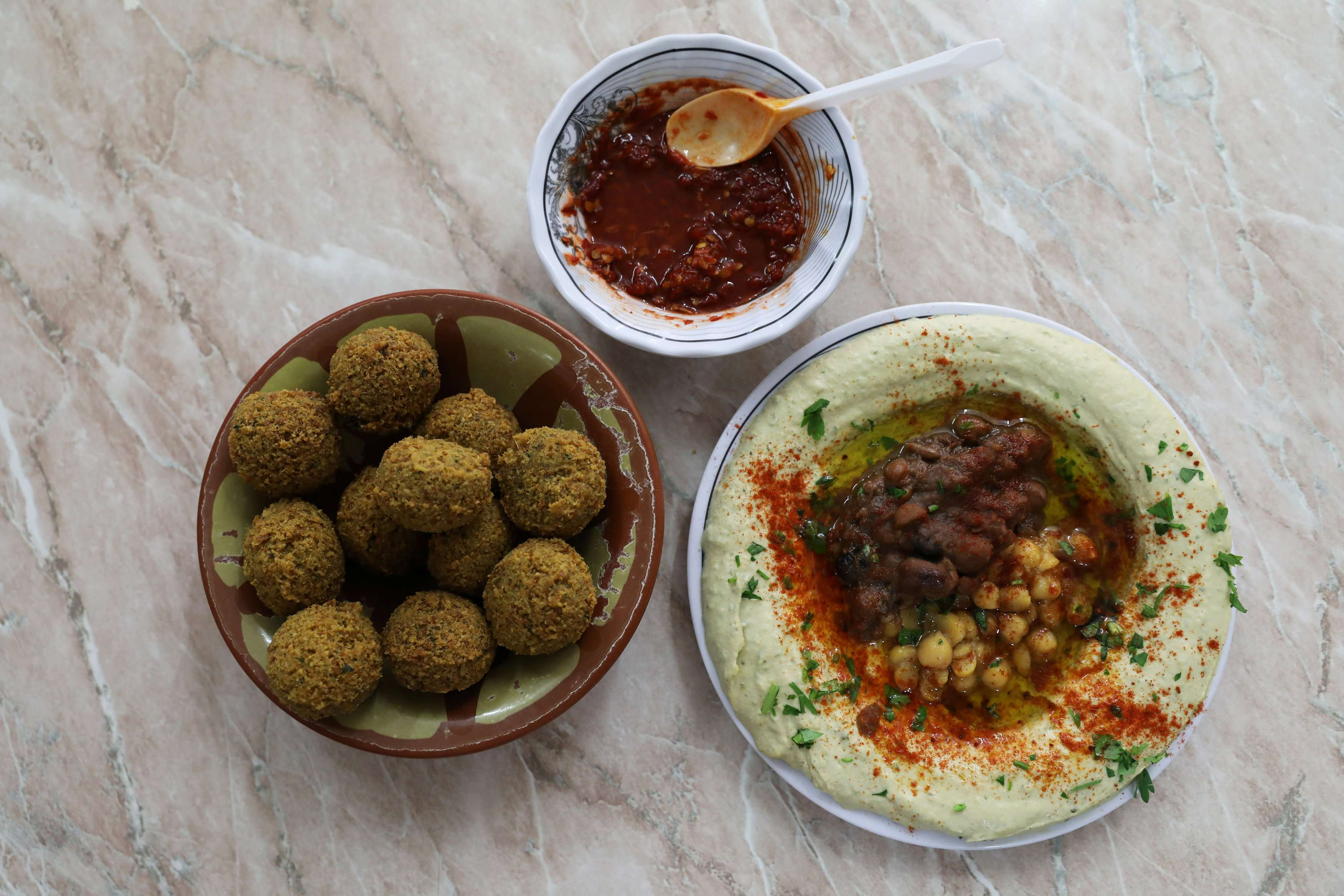 Chickpea-based hummus and falafel at the famed Abu Shukri restaurant in Jerusalem's Old City. (Reuters)