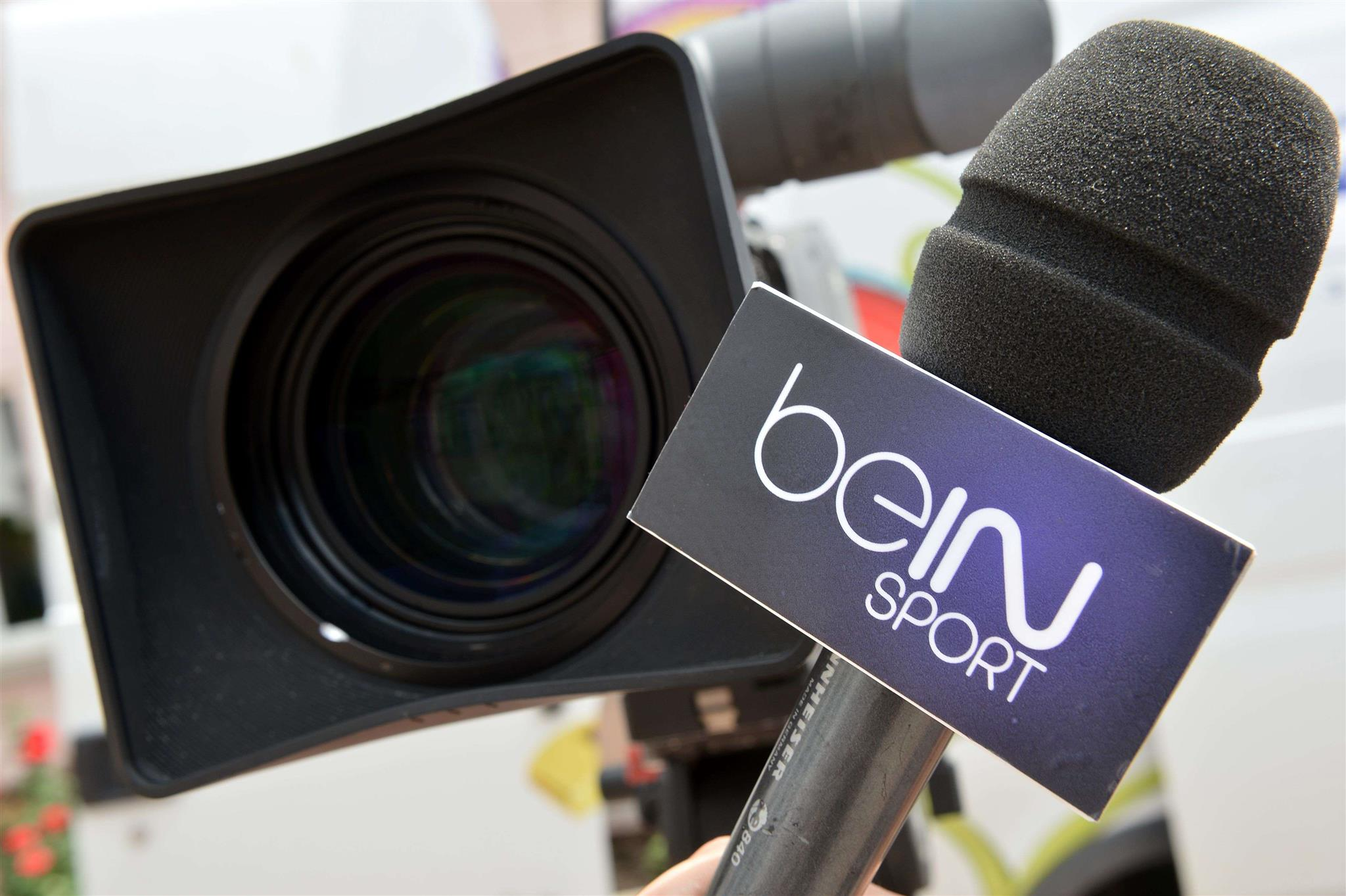 A file picture shows a microphone with the logo of the TV Sport channel beIN Sport. (AFP)