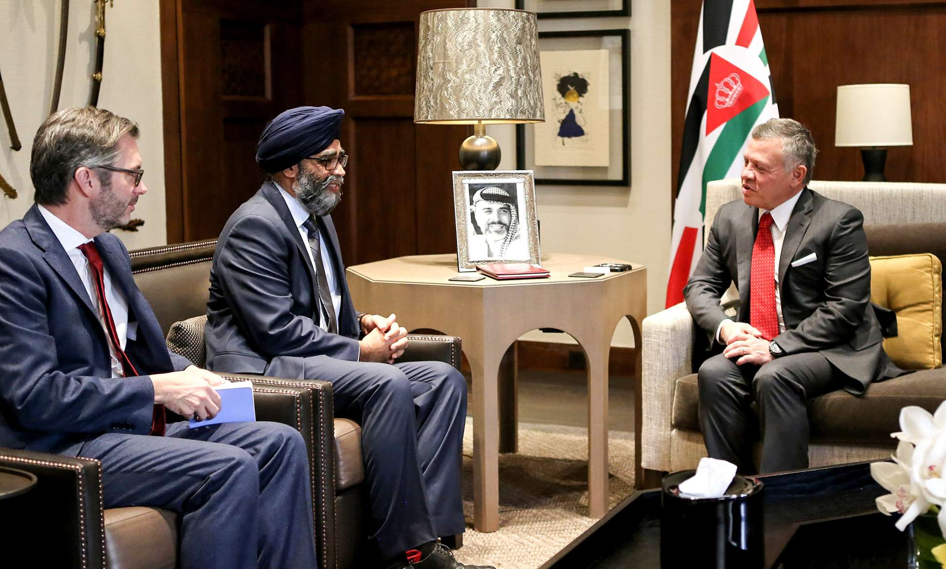 A 2017 file picture shows Jordanian King Abdullah II (R) receiving Canada's Defence Minister Harjit Singh Sajjan (C) in Amman.         (AFP)