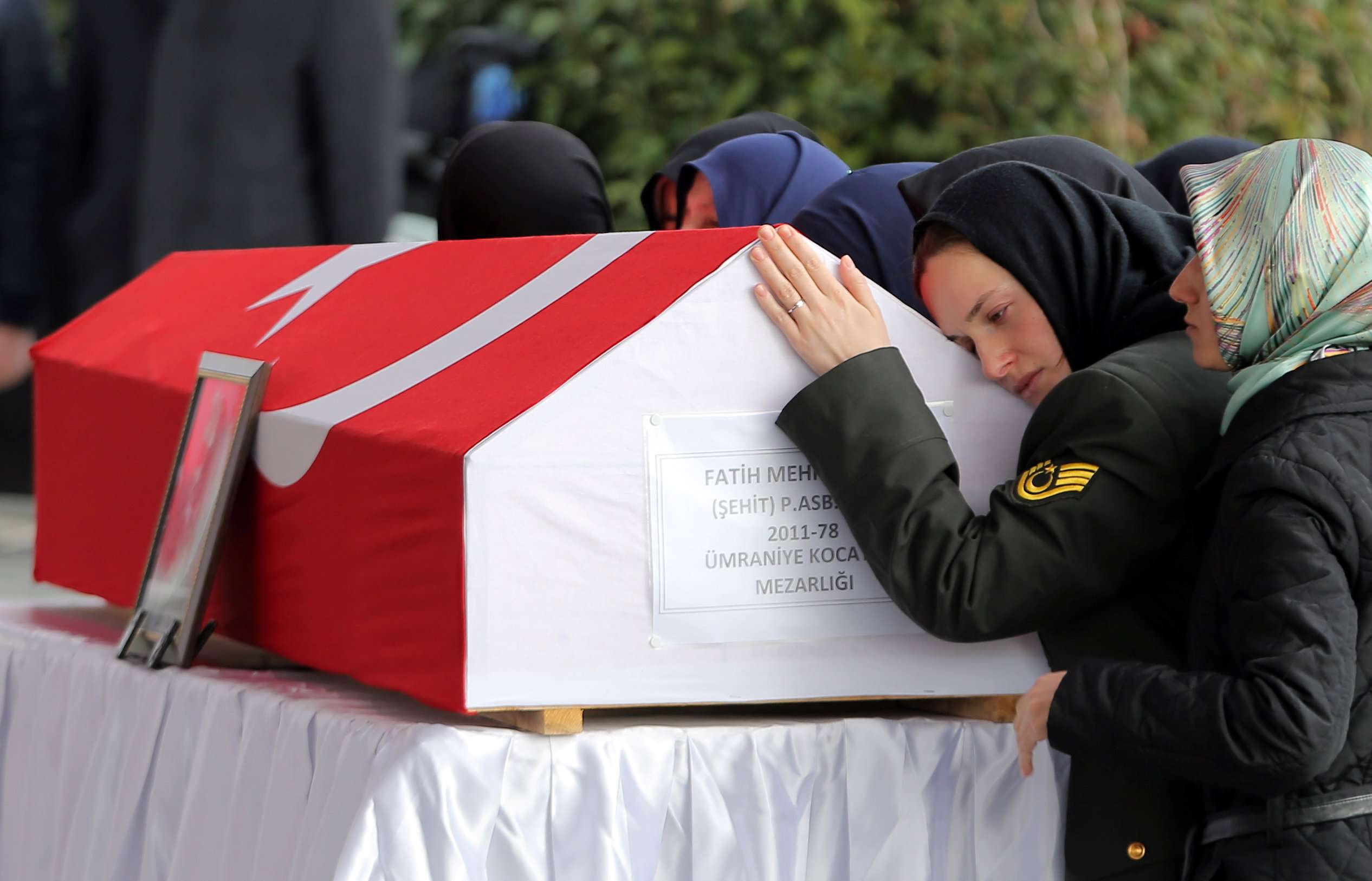 Relatives of a Turkish Army officer who was killed during the operation against Syria's Afrin region mourn during his funeral ceremony in Istanbul, on January 28. (Reuters)