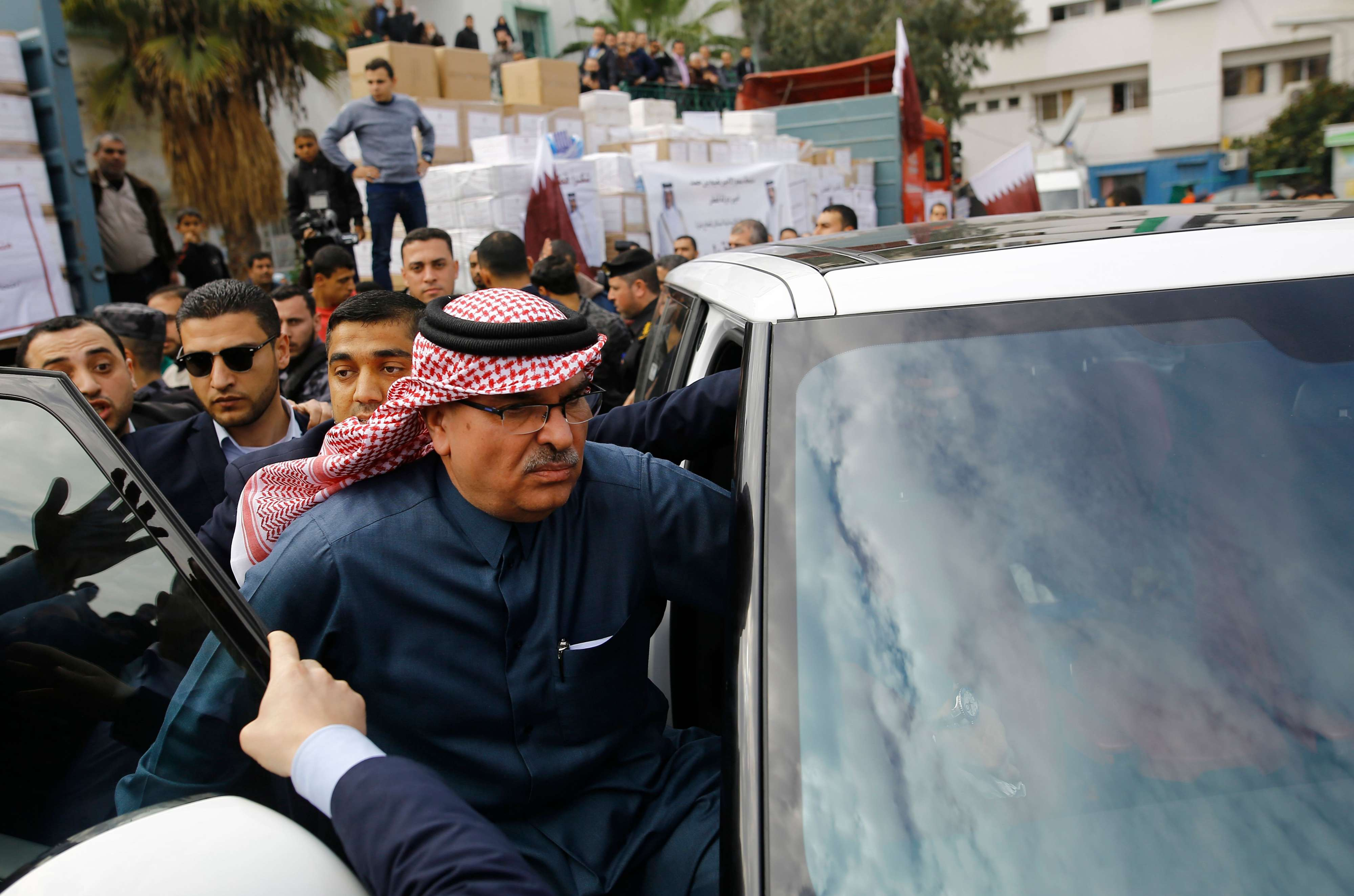 Qatari Ambassador to Gaza Mohammed al-Emadi (C) leaves following a news conference at the Dar al-Shifa hospital in Gaza City, on February 19.(AFP)