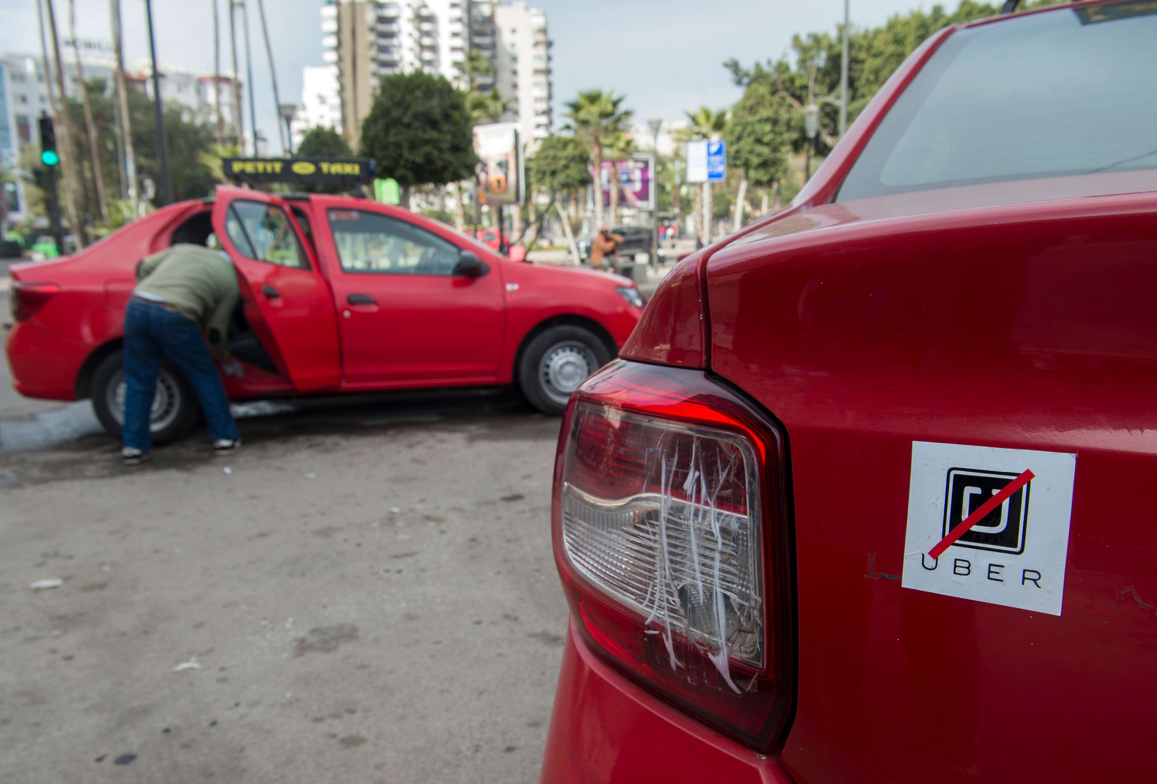 An anti-Uber sticker is seen on the back of a taxi in Casablanca. (AFP)