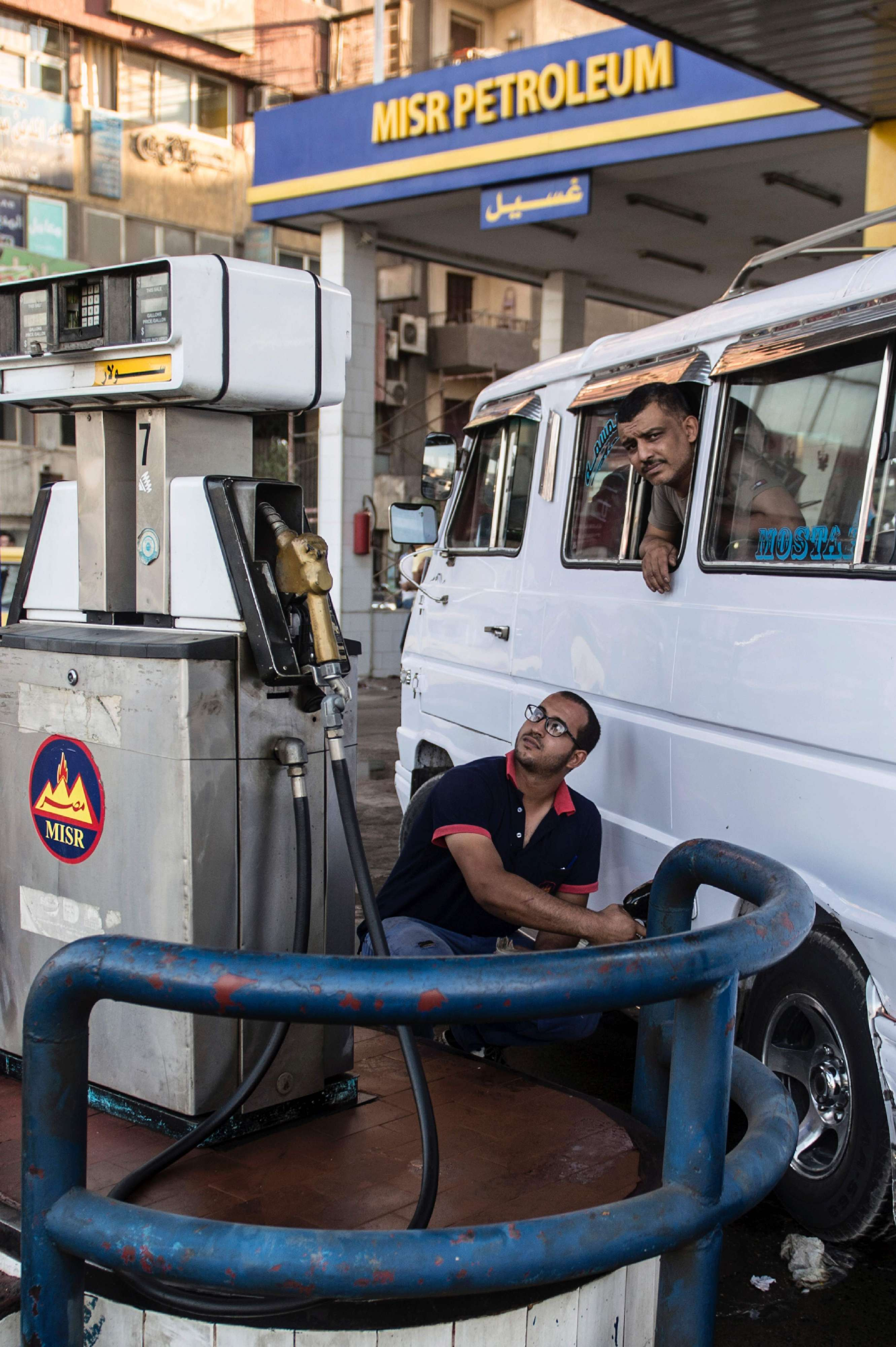 An Egyptian petrol station worker fills up a vehicle's tank in the capital Cairo.          (AFP)