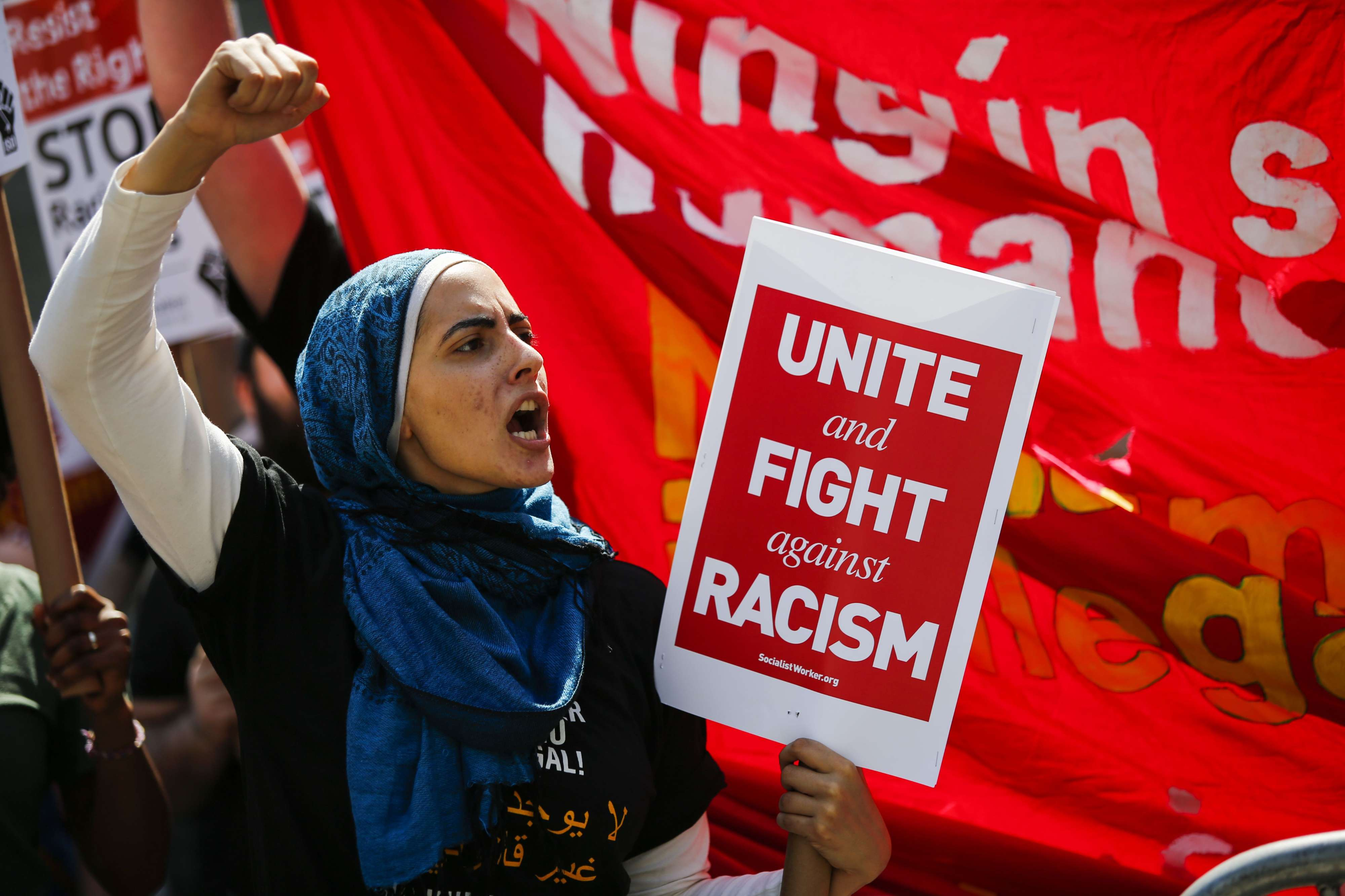 A woman shouts slogans in support of the US Muslim community at Foley Square in New York City, last June.   	     (AFP)