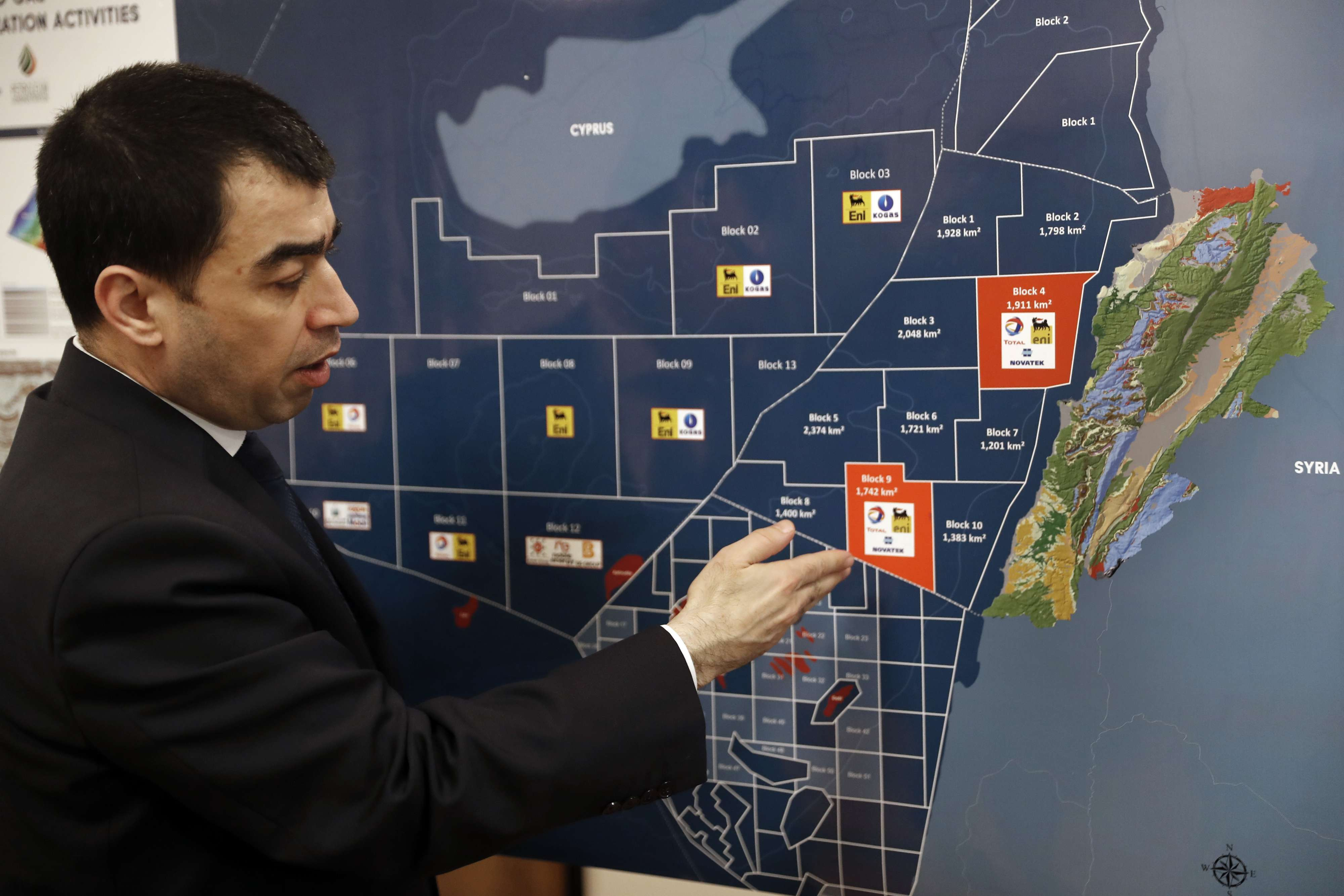 Lebanon's Energy Minister Cesar Abi Khalil points to a map as he speaks about the offshore Block 9 during an interview in Beirut, on February 1. (AP)