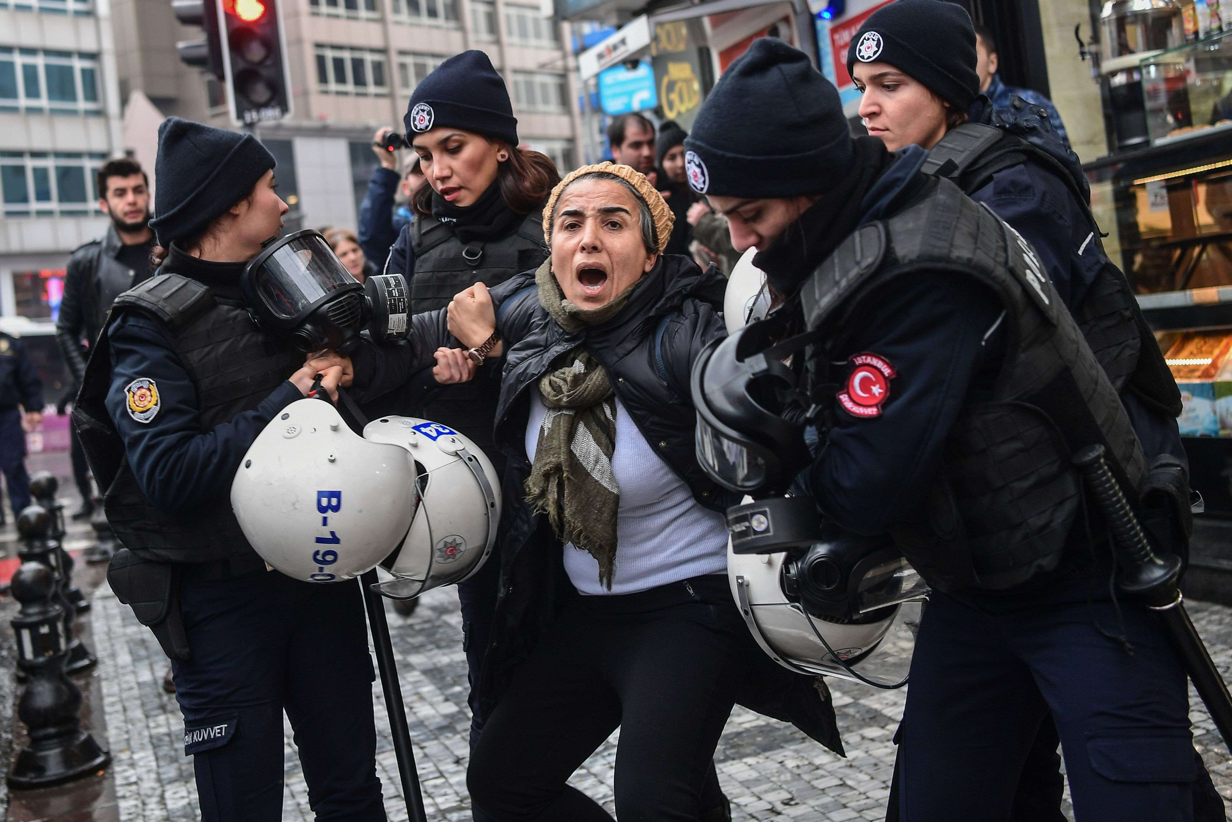 A woman reacts as Turkish anti-riot police officers arrest her during a demonstration in Istanbul called by the Peoples' Democratic Party to protest against Turkey's Operation Olive Branch in Syria, on January 21. (AFP)
