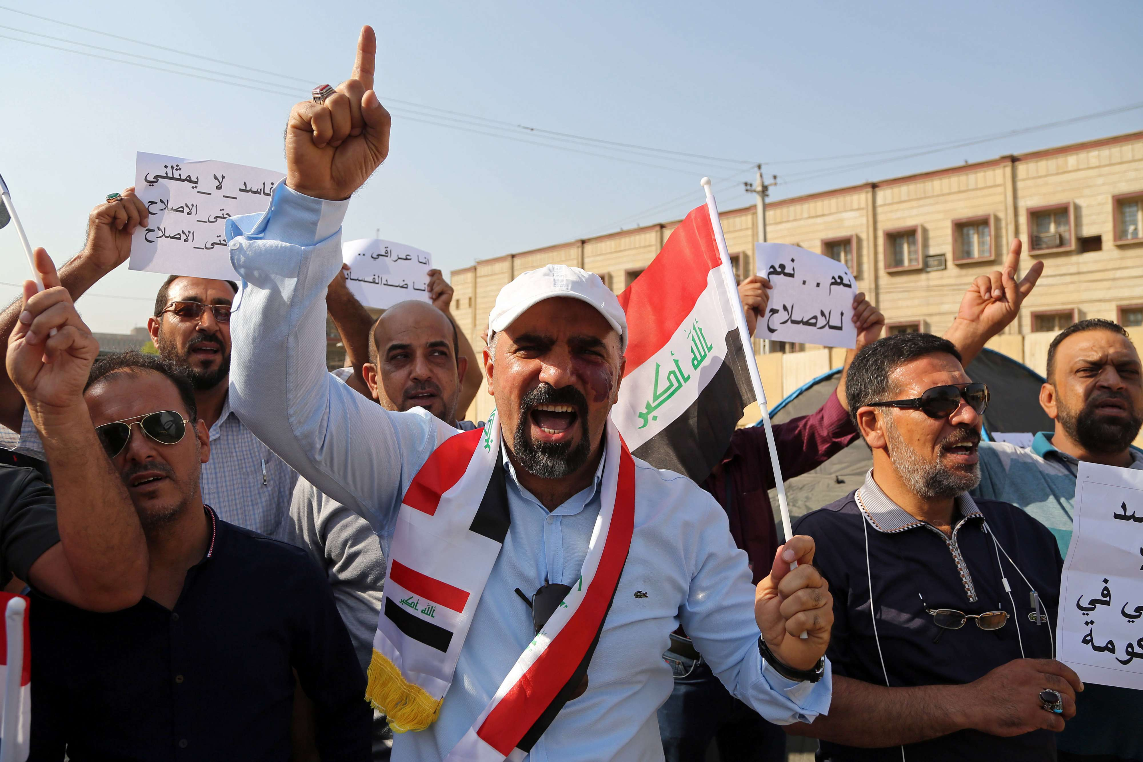 A 2016 file picture shows Iraqis protesting against wide-scale corruption in front of government offices in Baghdad.  (AP)