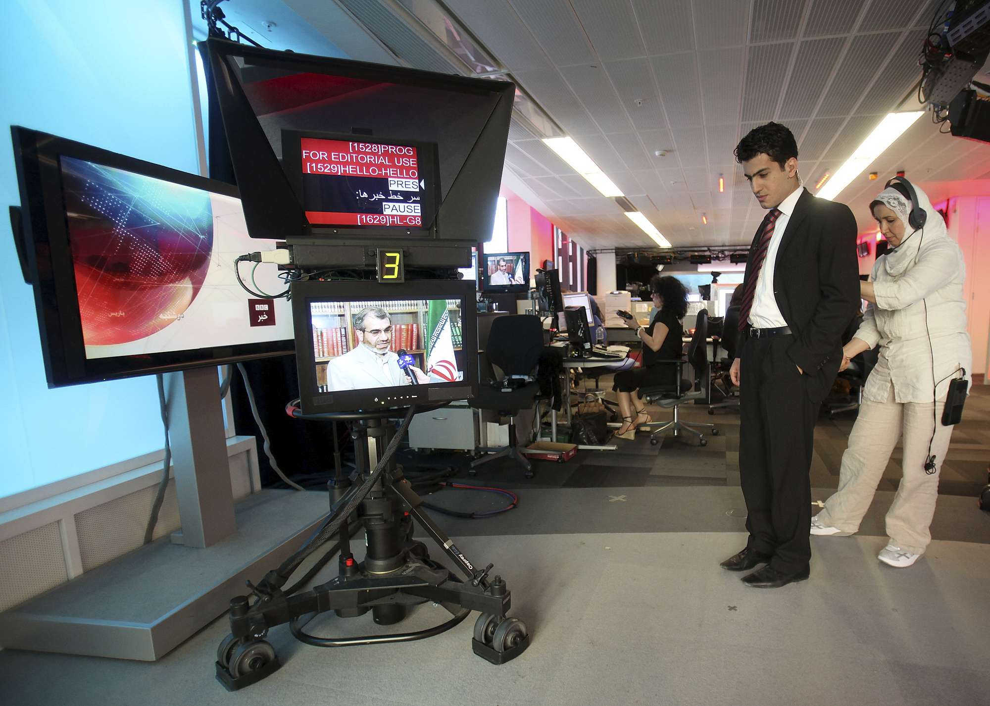 Serious challenge. A BBC Persian service presenter gets ready to present the news at the corporation's headquarters in London. (AP)