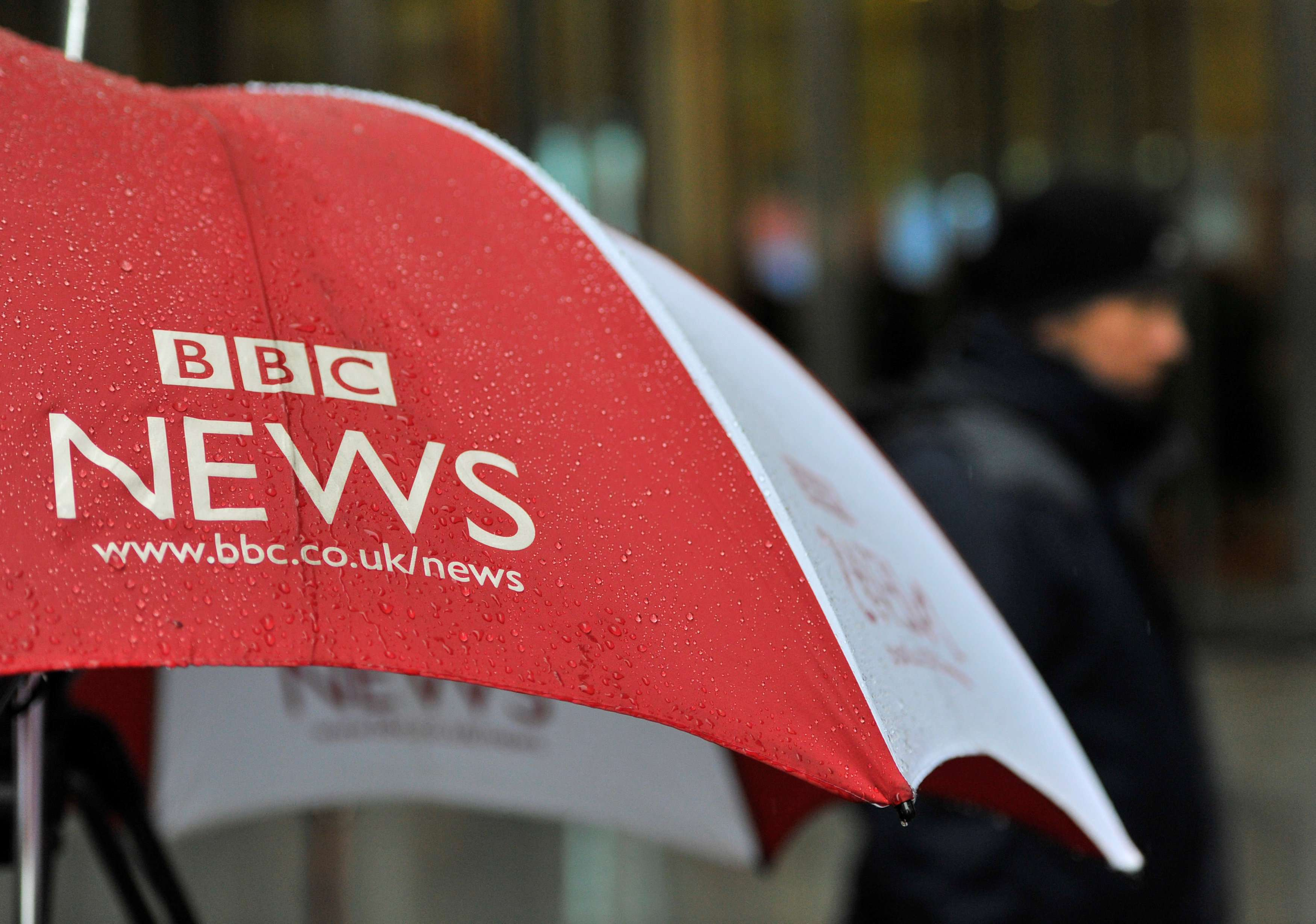 A BBC umbrella protects broadcast equipment outside the BBC's New Broadcasting House in London. (Reuters)