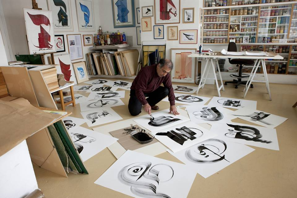 Uplifling messages. Iraqi master calligrapher Hassan Massoudy at work.                                 (October Gallery)