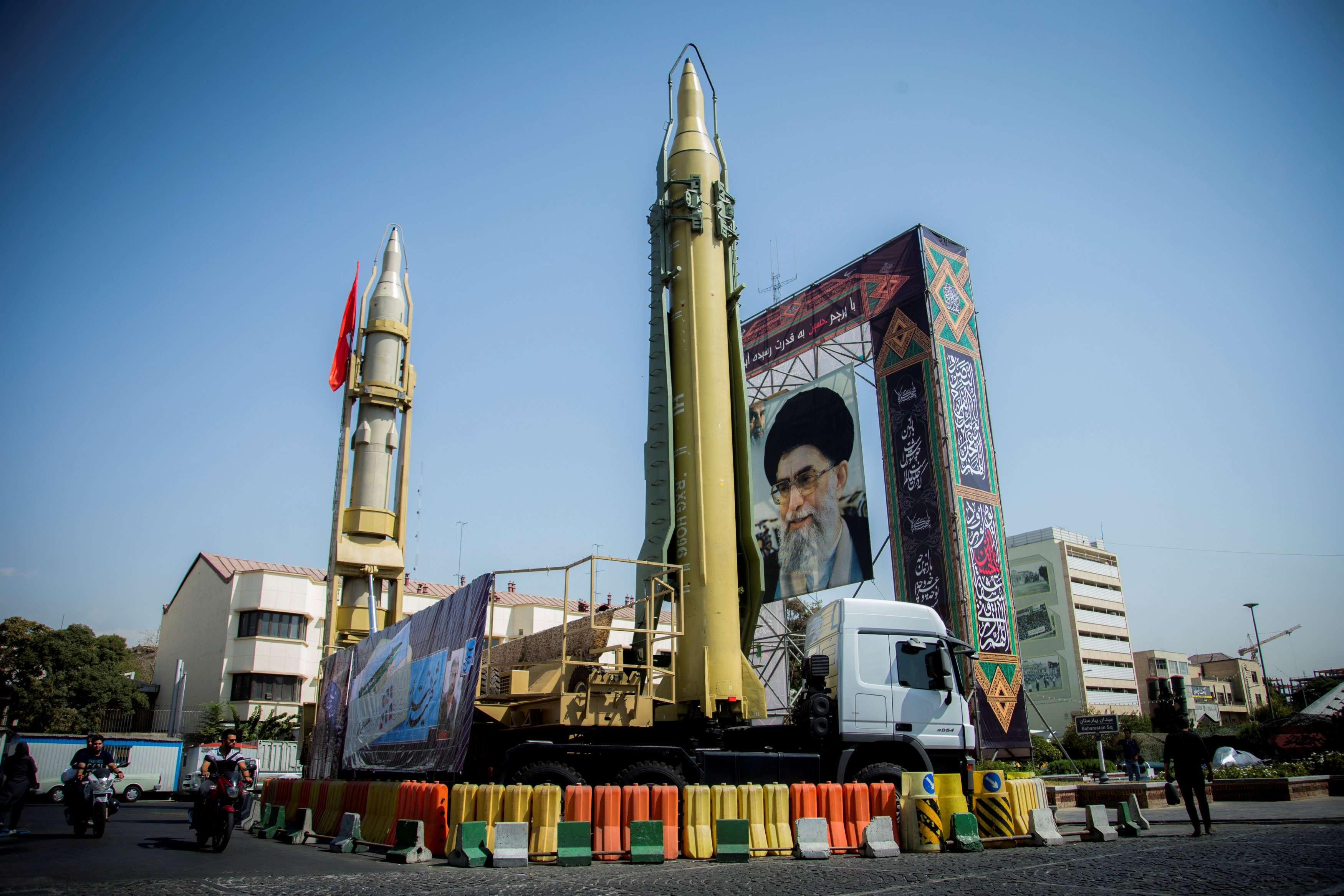 A display featuring missiles and a portrait of Iran's Supreme Leader Ayatollah Ali Khamenei is seen at Baharestan Square in Tehran. (Reuters)