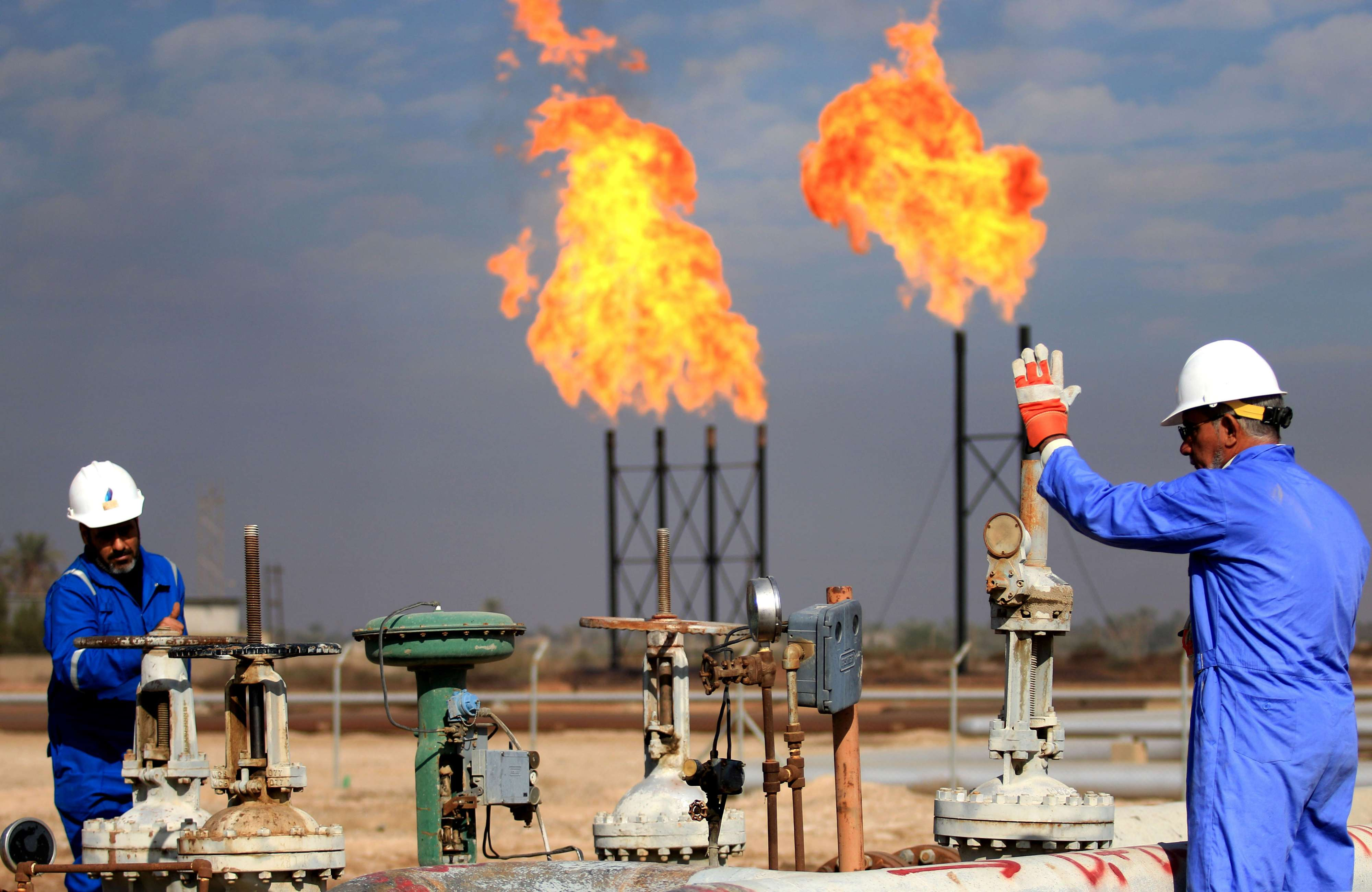 Workers at Iraq's Bin Omar natural gas facility, north of the southern port of Basra. (AFP)