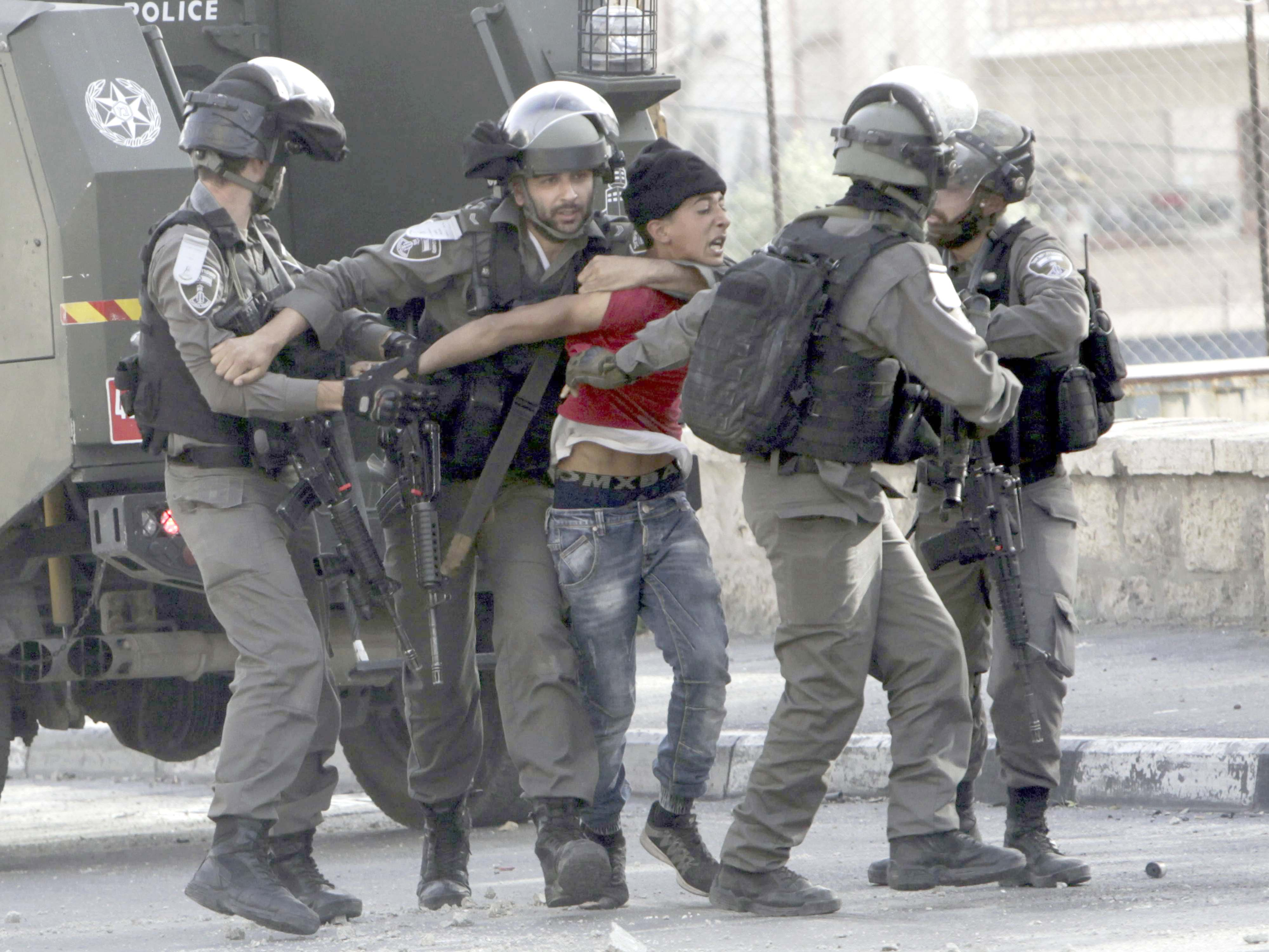 Israeli police arrest a young Palestinian during clashes in the West Bank city of Bethlehem, last April. (AP)