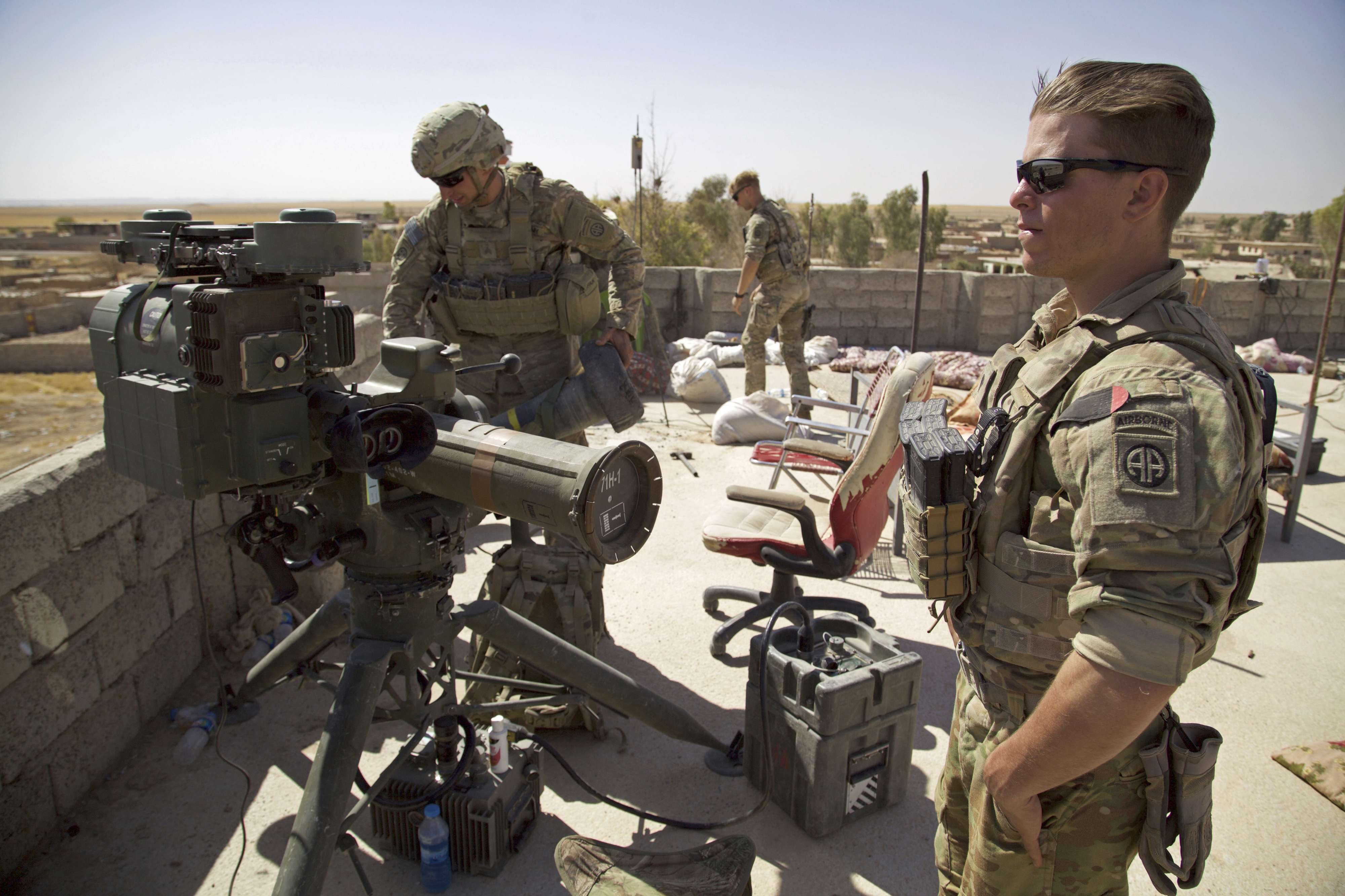 US Army soldiers stand next to a guided-missile launcher in the Iraqi village of Abu Ghaddur, last year. (AP)