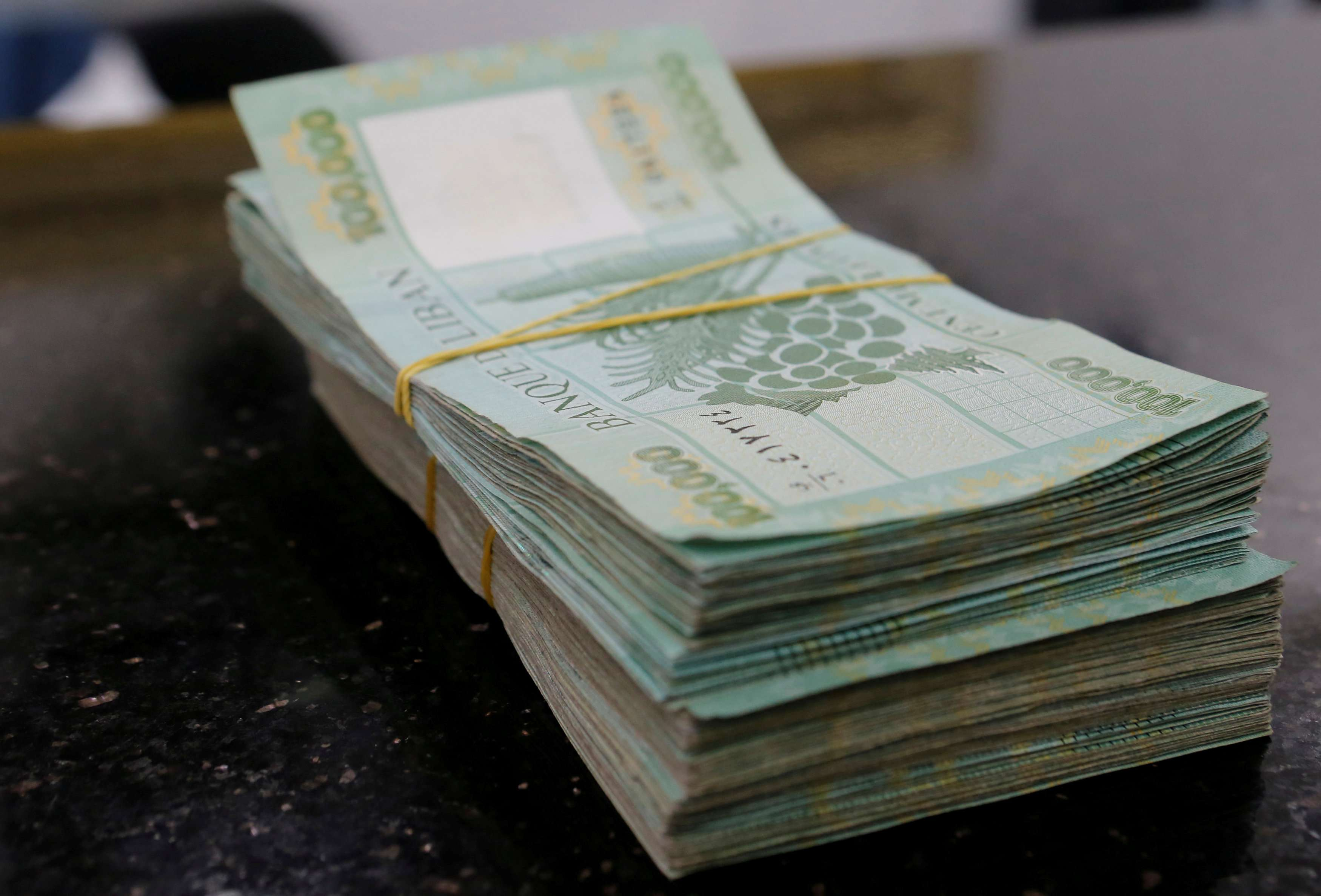 Help needed. Lebanese pound banknotes are displayed at a money exchange shop in Beirut. (Reuters)