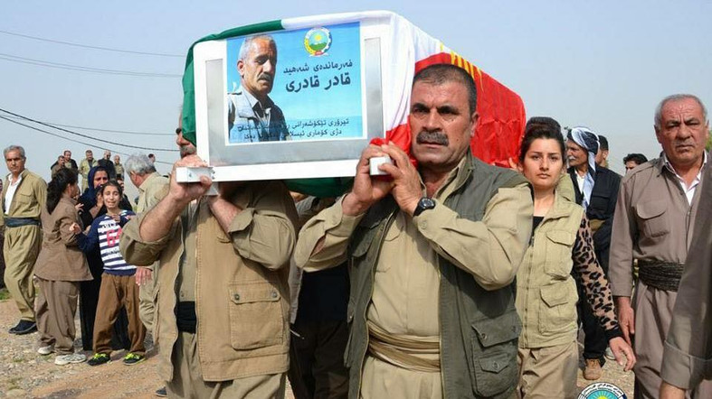 Covert war. Peshmerga fighters with the Kurdish Democratic Party of Iran (KDPI) carry the coffin of Qader Qaderi who was killed in Iraq's Sulaimaniyah province. (KDP Media)