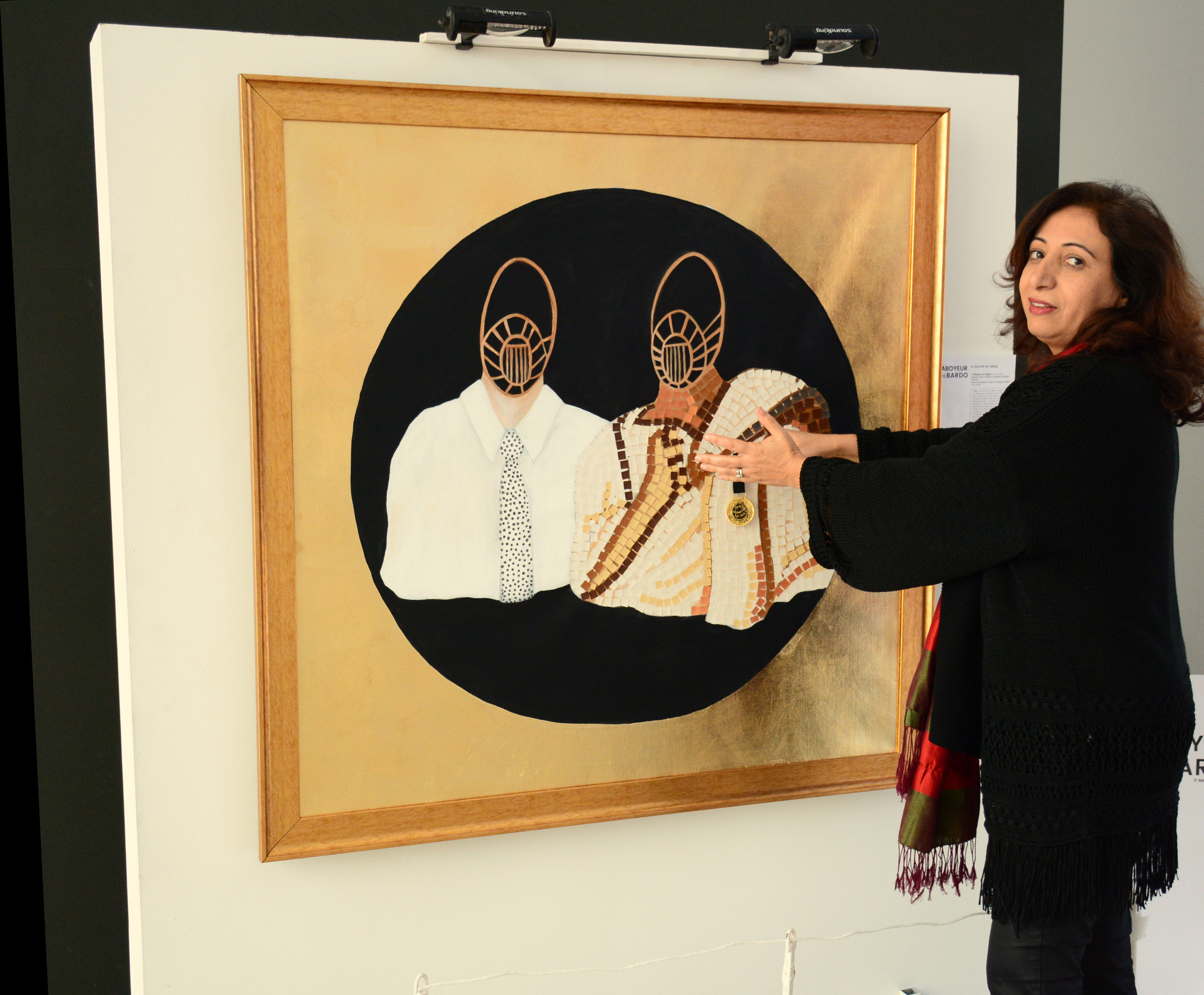 Tunisian artist Faten Rouissi shows a work that depicts the character of the Barker (L) bestowing the National Order of Cultural Merit to Virgil.              (Khaoula ben Amara)