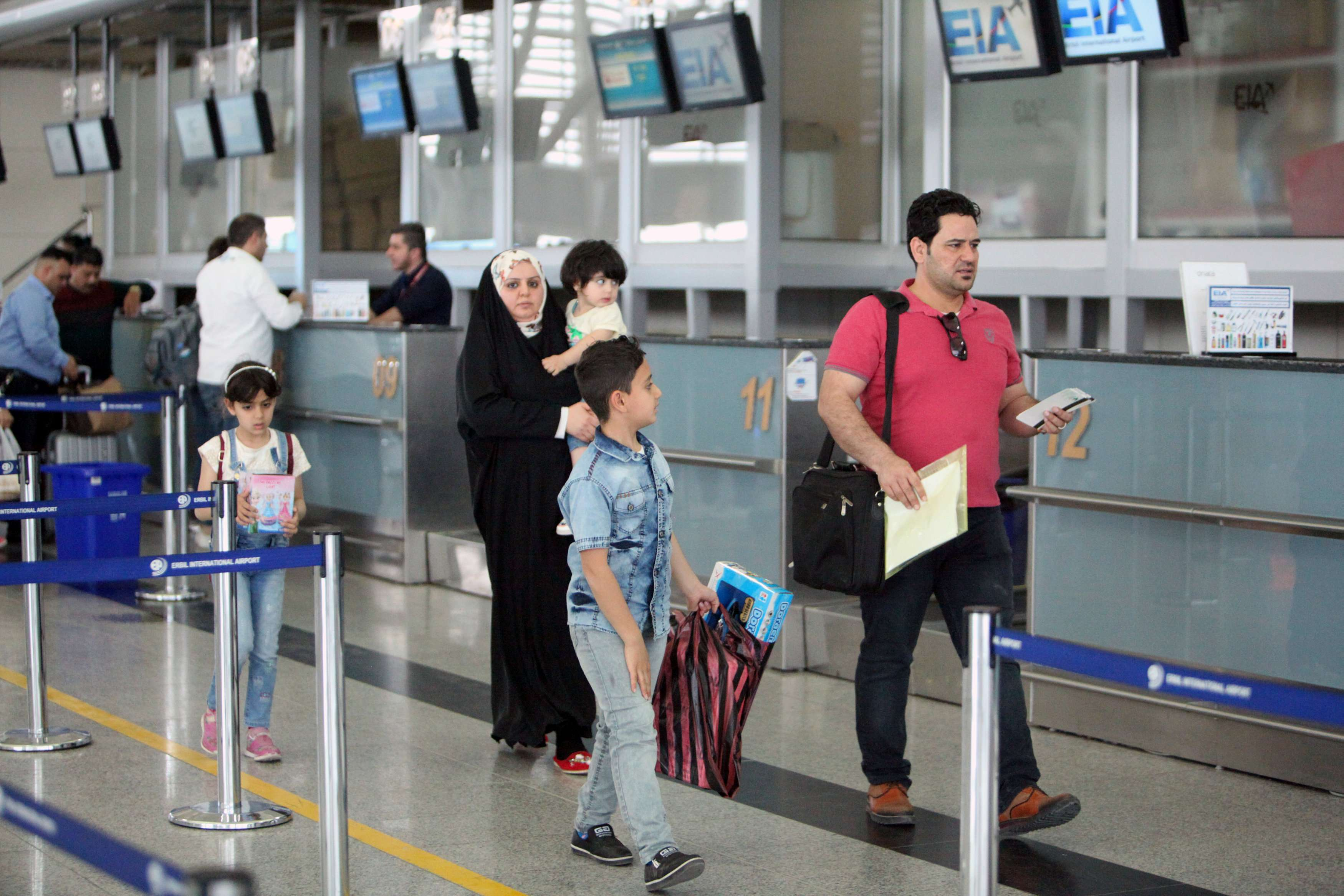 Passengers are seen at Erbil International Airport, on March 15. (Reuters)