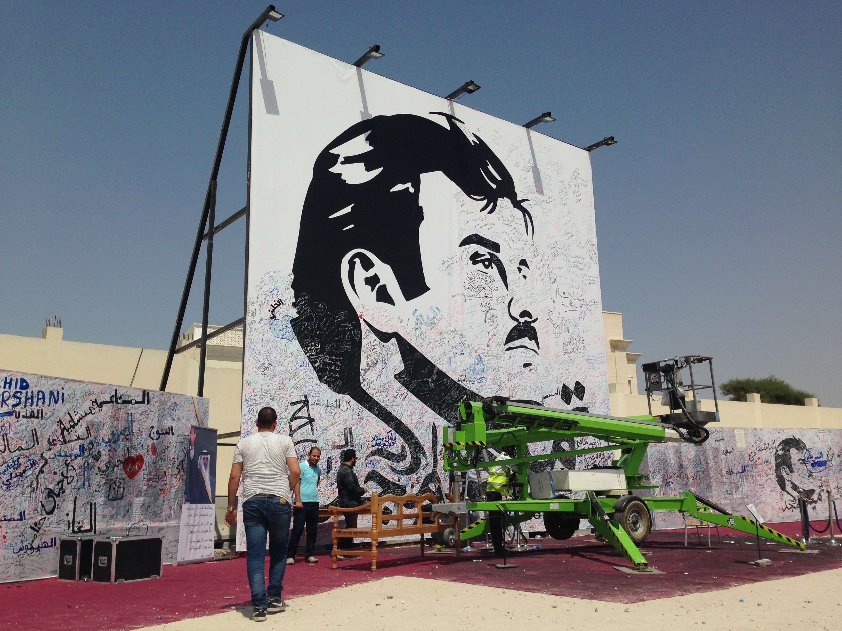 A black-and-white depiction of Qatar's Emir Sheikh Tamim bin Hamad al-Thani that was put up by authorities to attract signatures and comments from residents is seen in Doha.(AP)