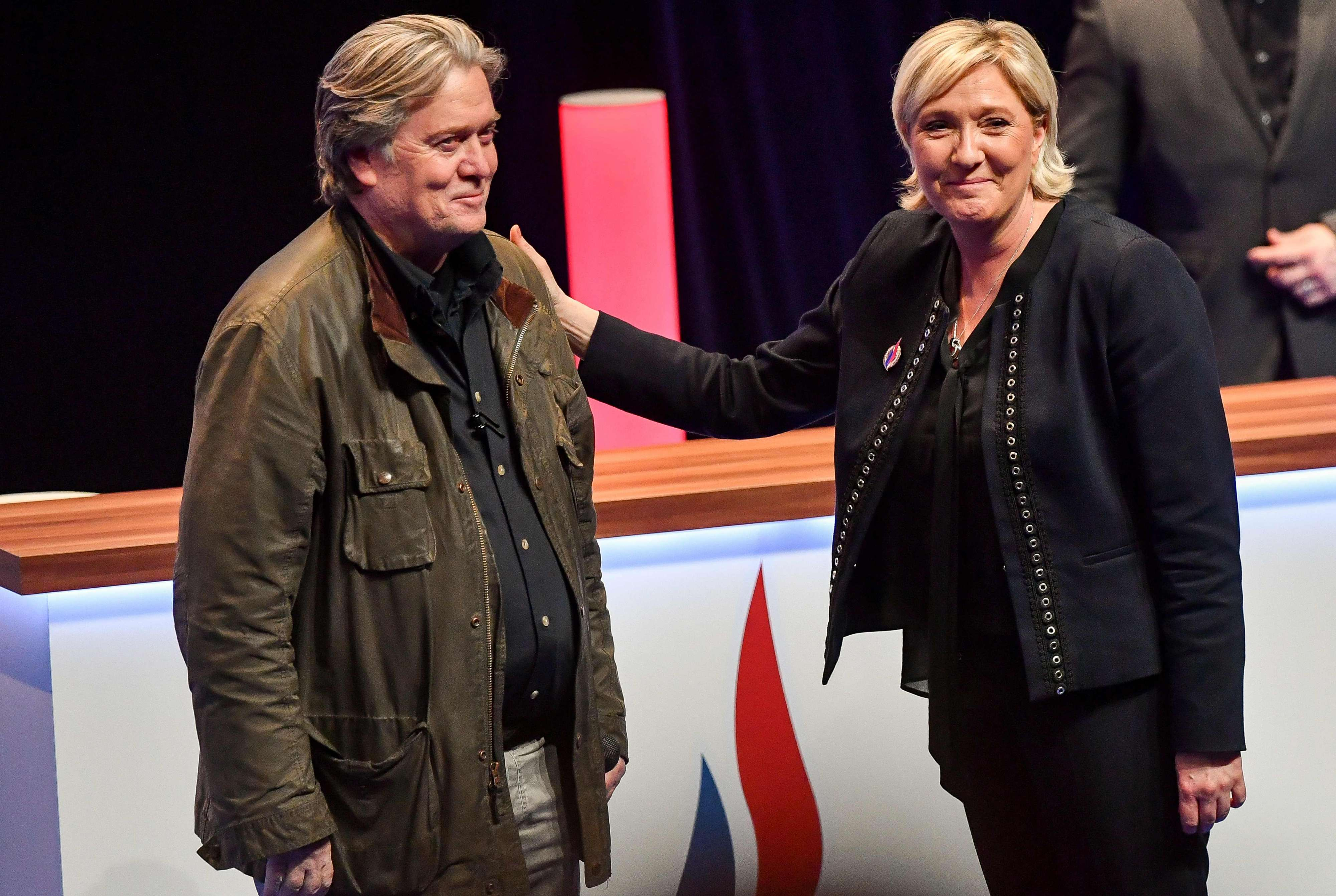 France's far-right party Front National (FN) leader Marine Le Pen (R) stands with former US president adviser Stephen Bannon after his speech at the Grand Palais in Lille, on March 10.   (AFP)