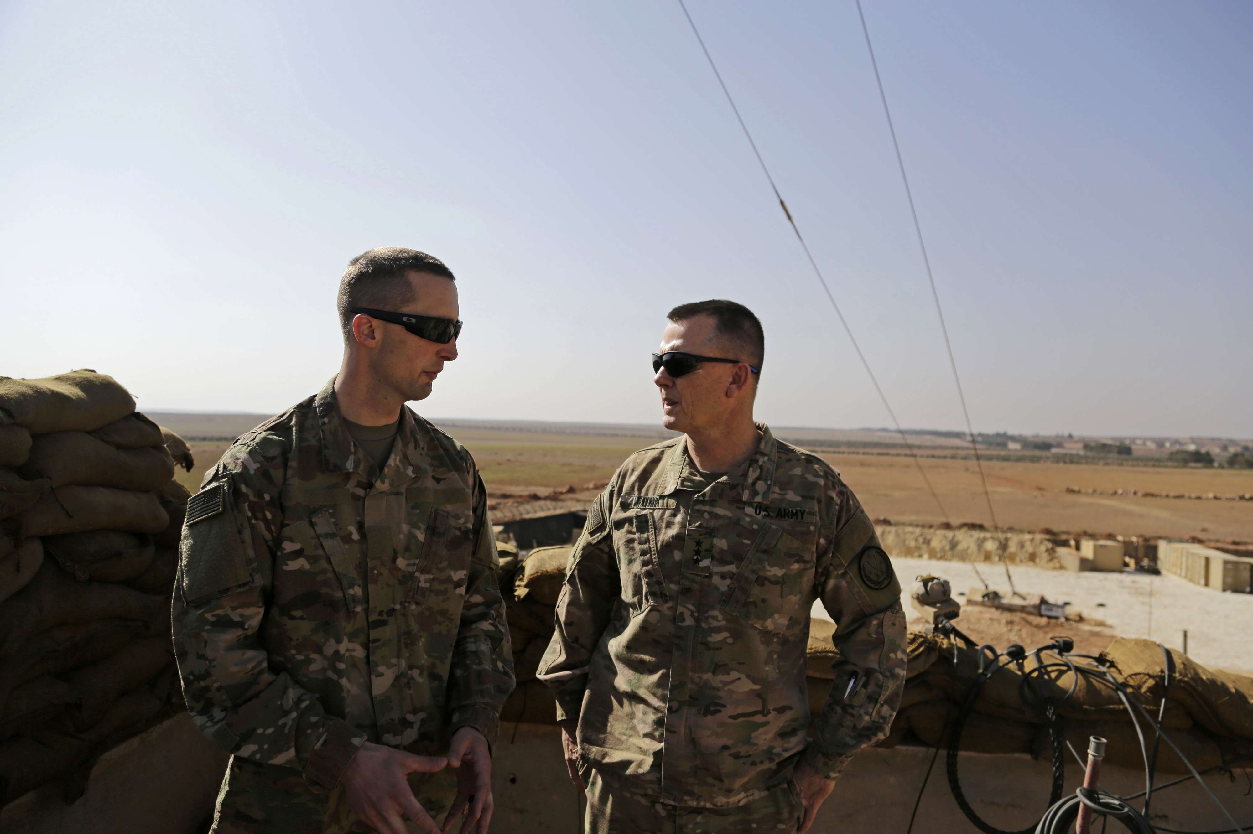US Army Captain Timothy Skinner (L) and US Army Lieutenant-General Paul Funk consult at an American outpost in Manbij, on February 7. (AP)