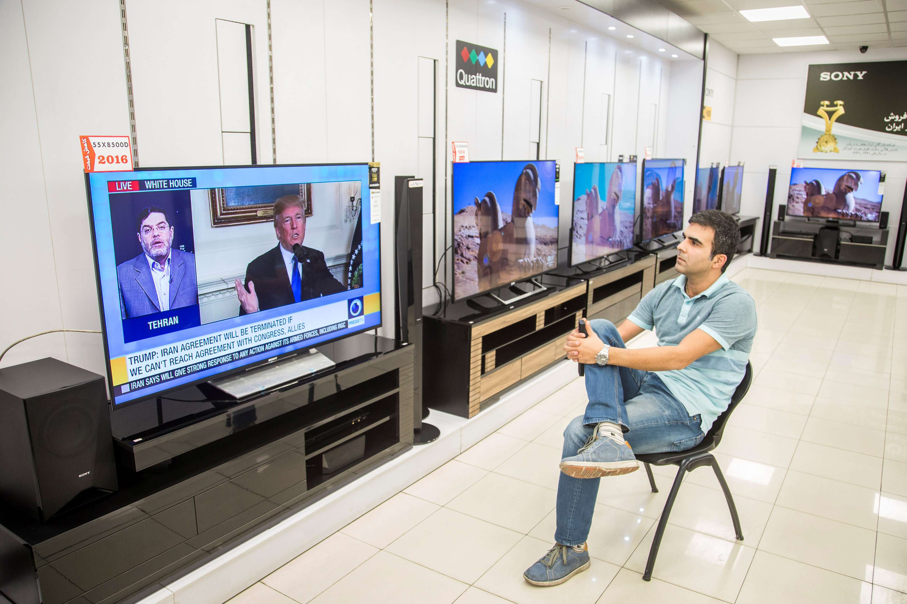 An Iranian man watches a television broadcast of US President Donald Trump's speech on the 2015 nuclear deal with Iran, last October.  (Reuters)