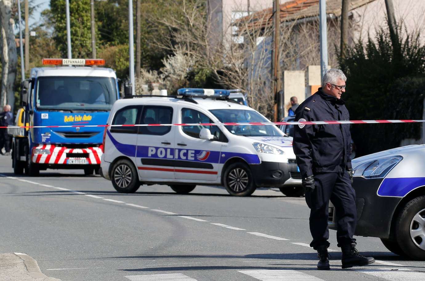 French security officers walk past a cordoned off area in Carcassonne near the supermarket of Trebes, on March 23 on March 23. (Reuters)