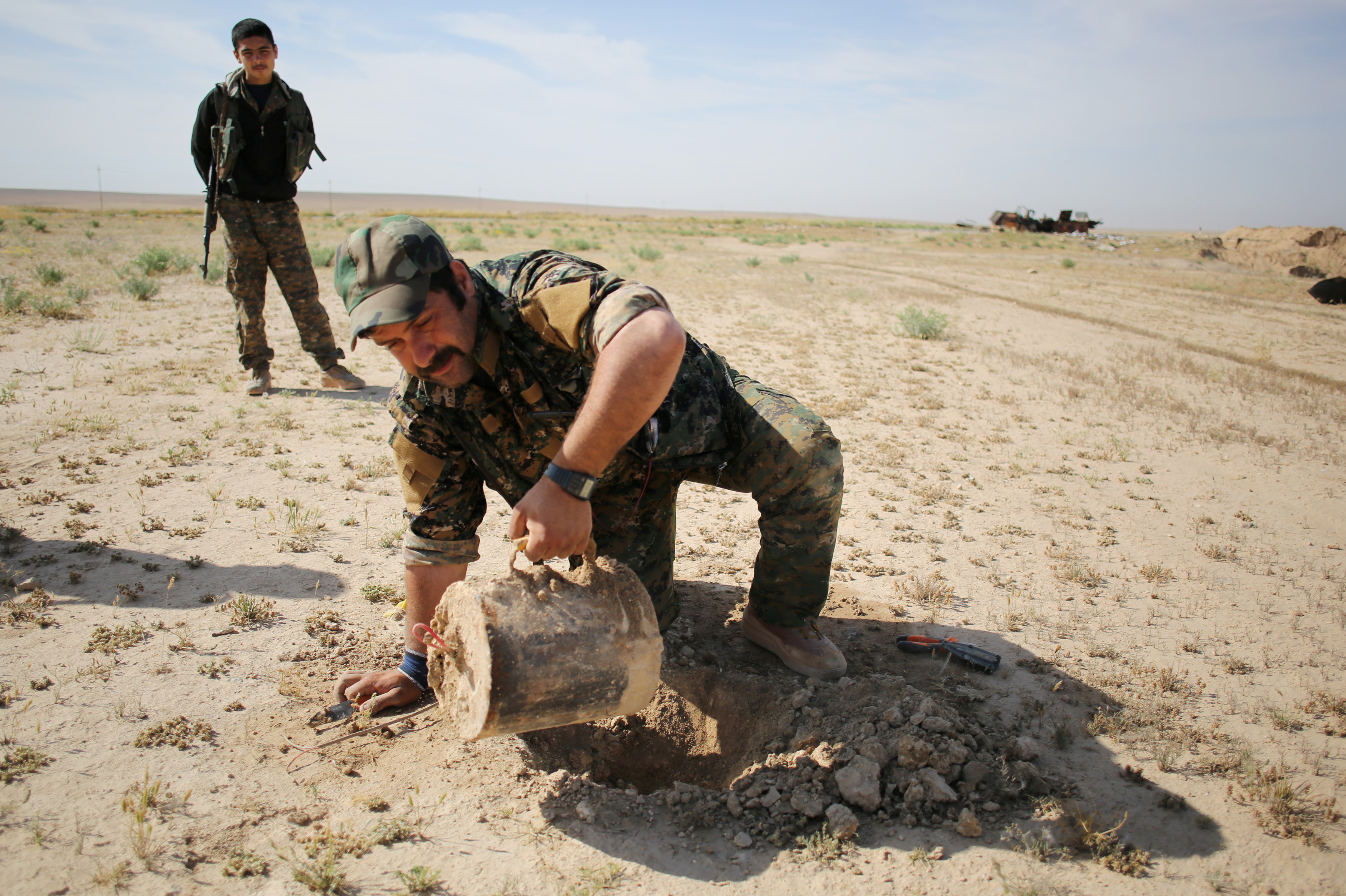 A 2016 file picture shows a member of the PKK-affiliated Yazidi militia, Sinjar Resistance Units, disarming an improvised explosive device near the village of Umm al-Dhiban in northern Iraq. (Reuters)