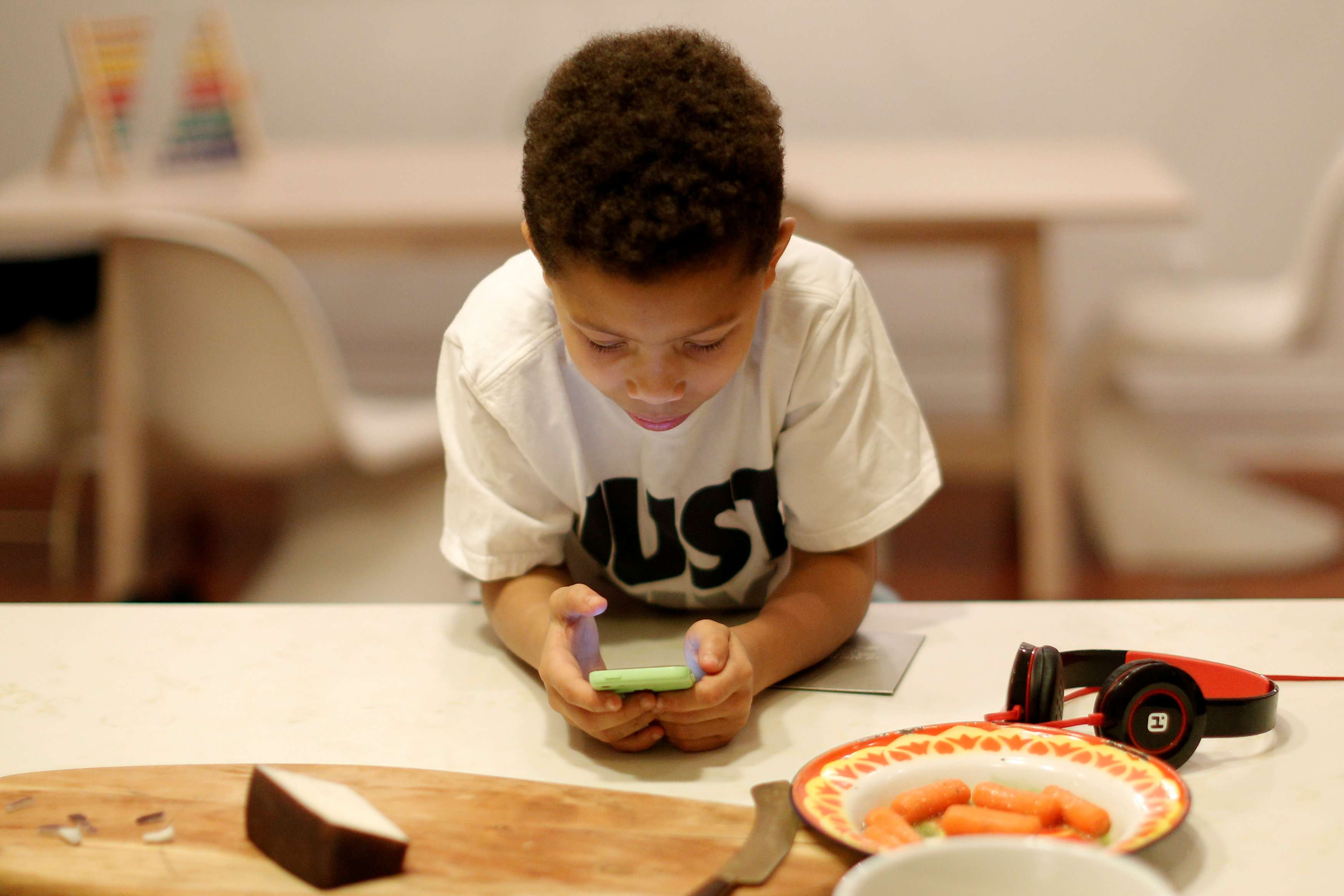 A challenge to parents. A little boy plays a game on his phone. (Reuters)