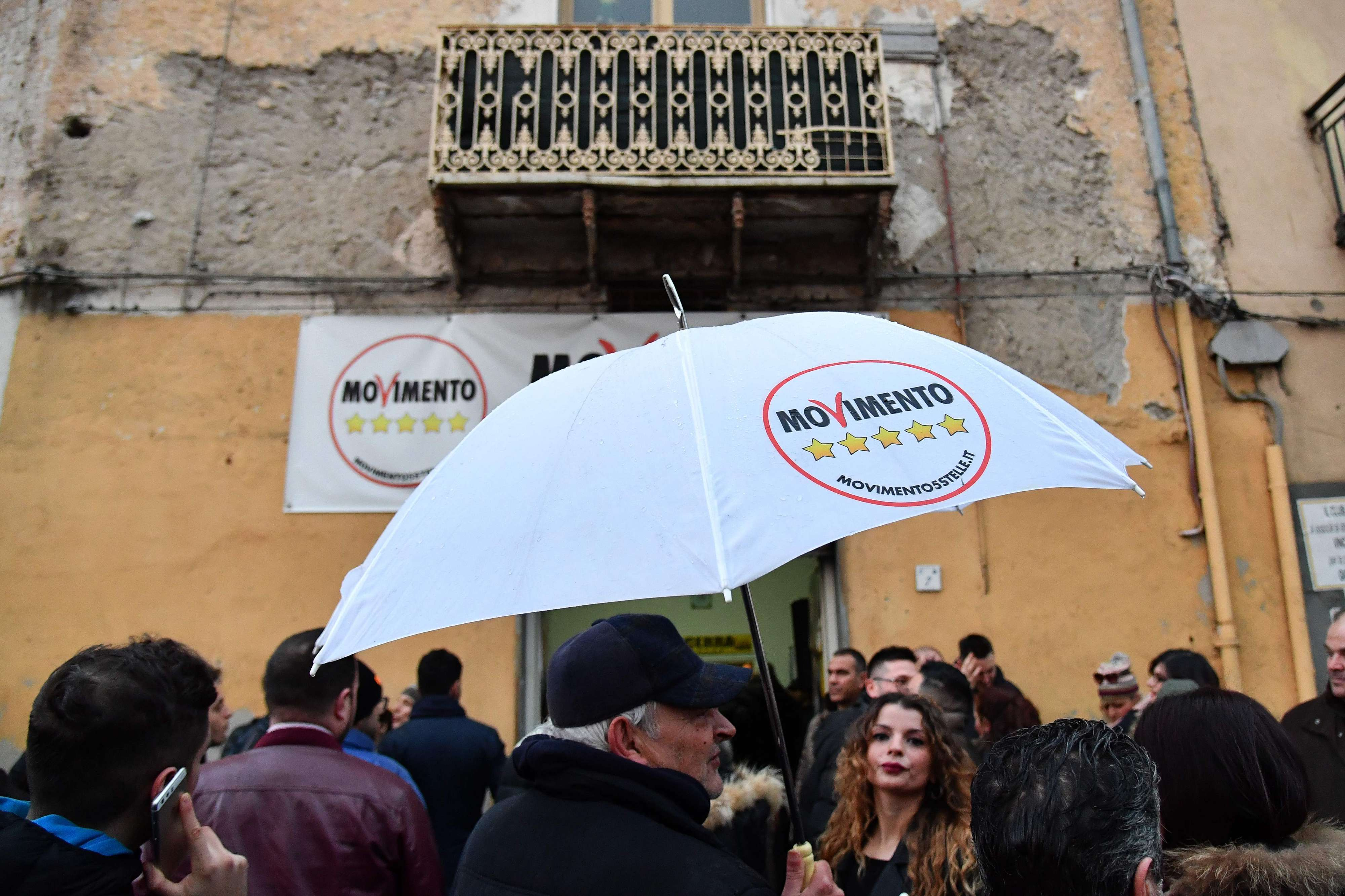 Supporters of populist Five Star Movement (M5S) party wait for their leader Luigi Di Maio to arrive at a meeting in Acerra, on March 6.  (AFP)