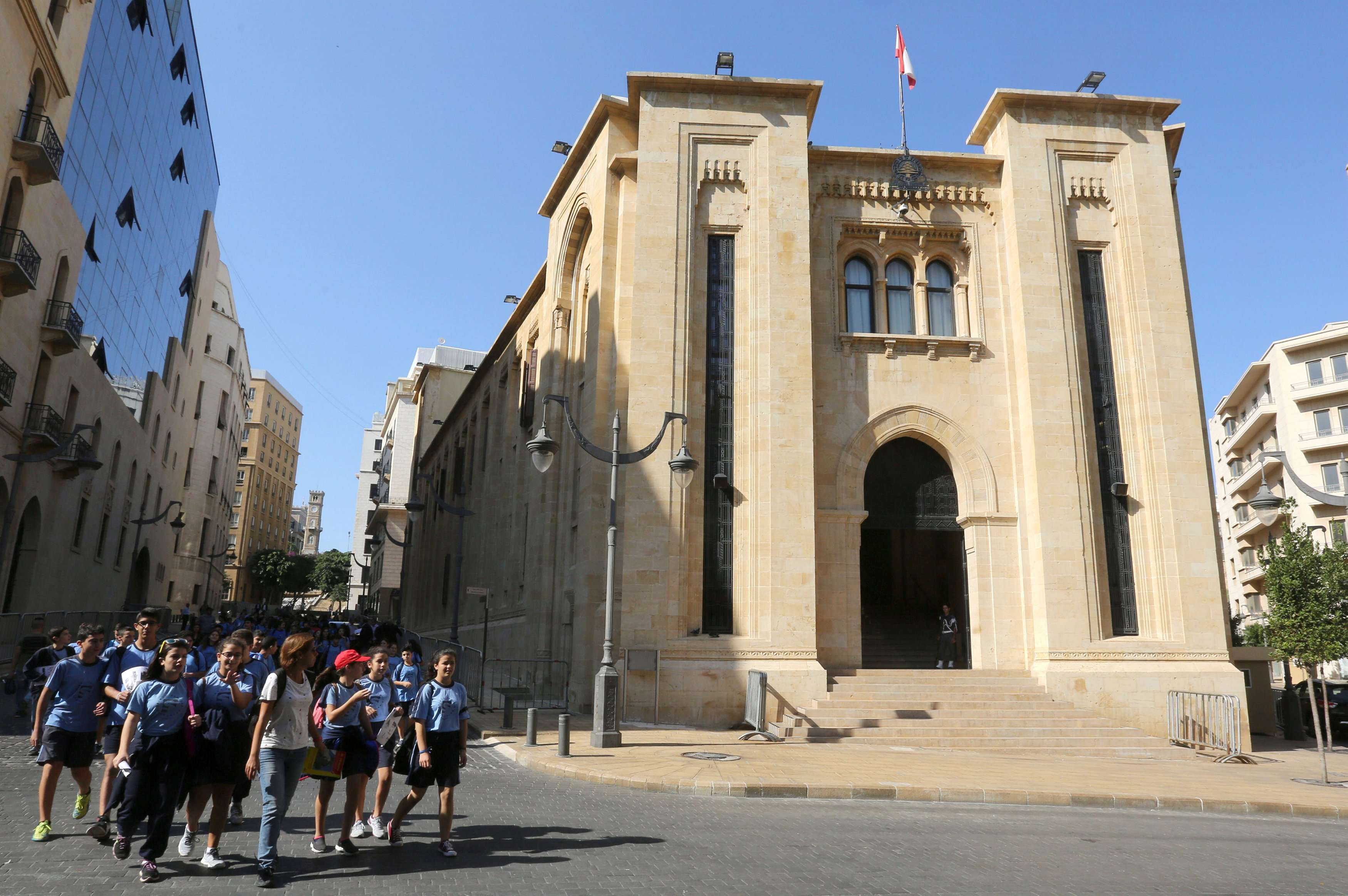Students walk outside the parliament building in Beirut, last November. (Reuters)