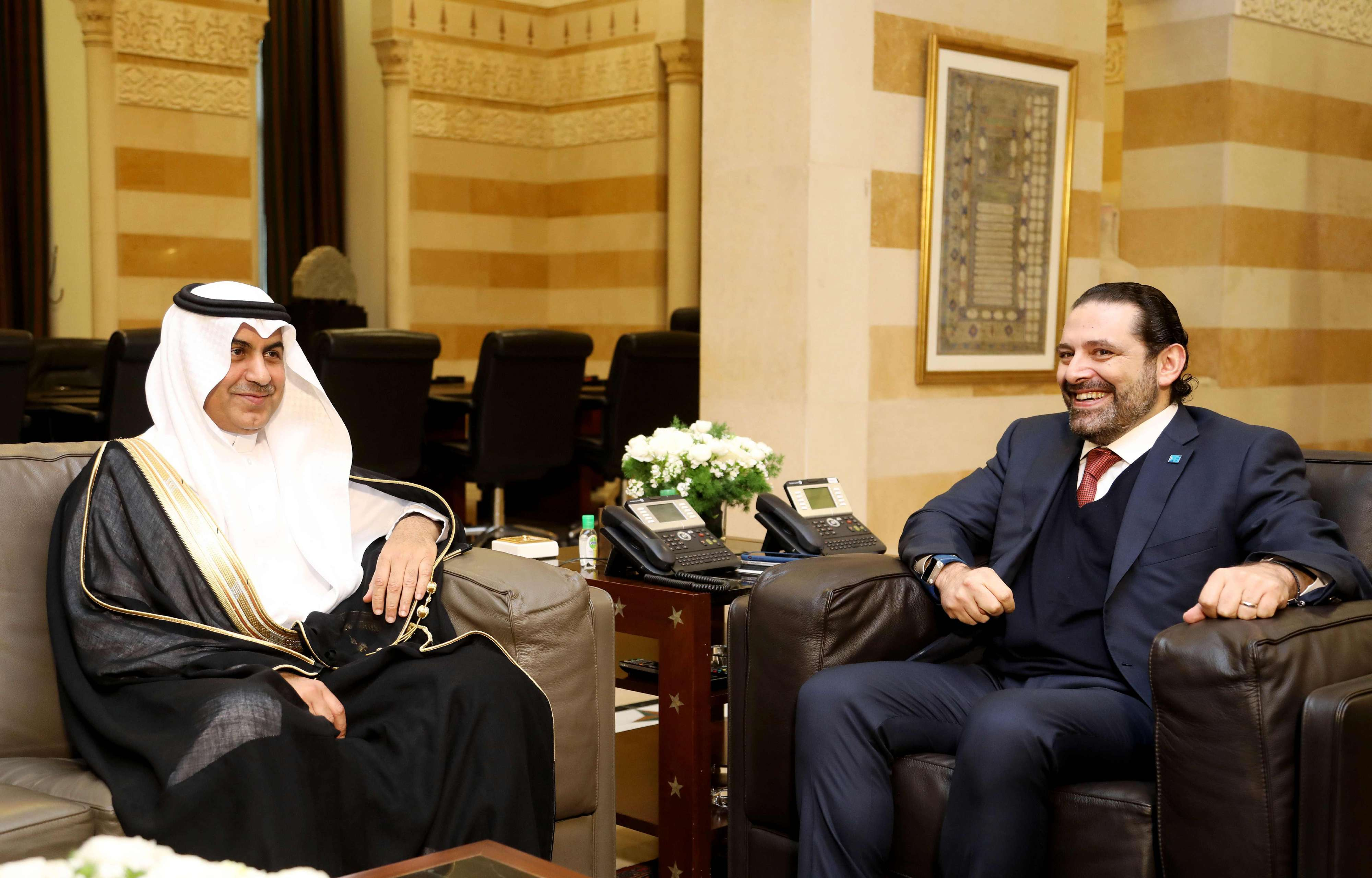 Lebanese Prime Minister Saad Hariri (R) meets with Saudi envoy Nizar al-Aloula at the governmental palace in Beirut, on February 26. (AFP)
