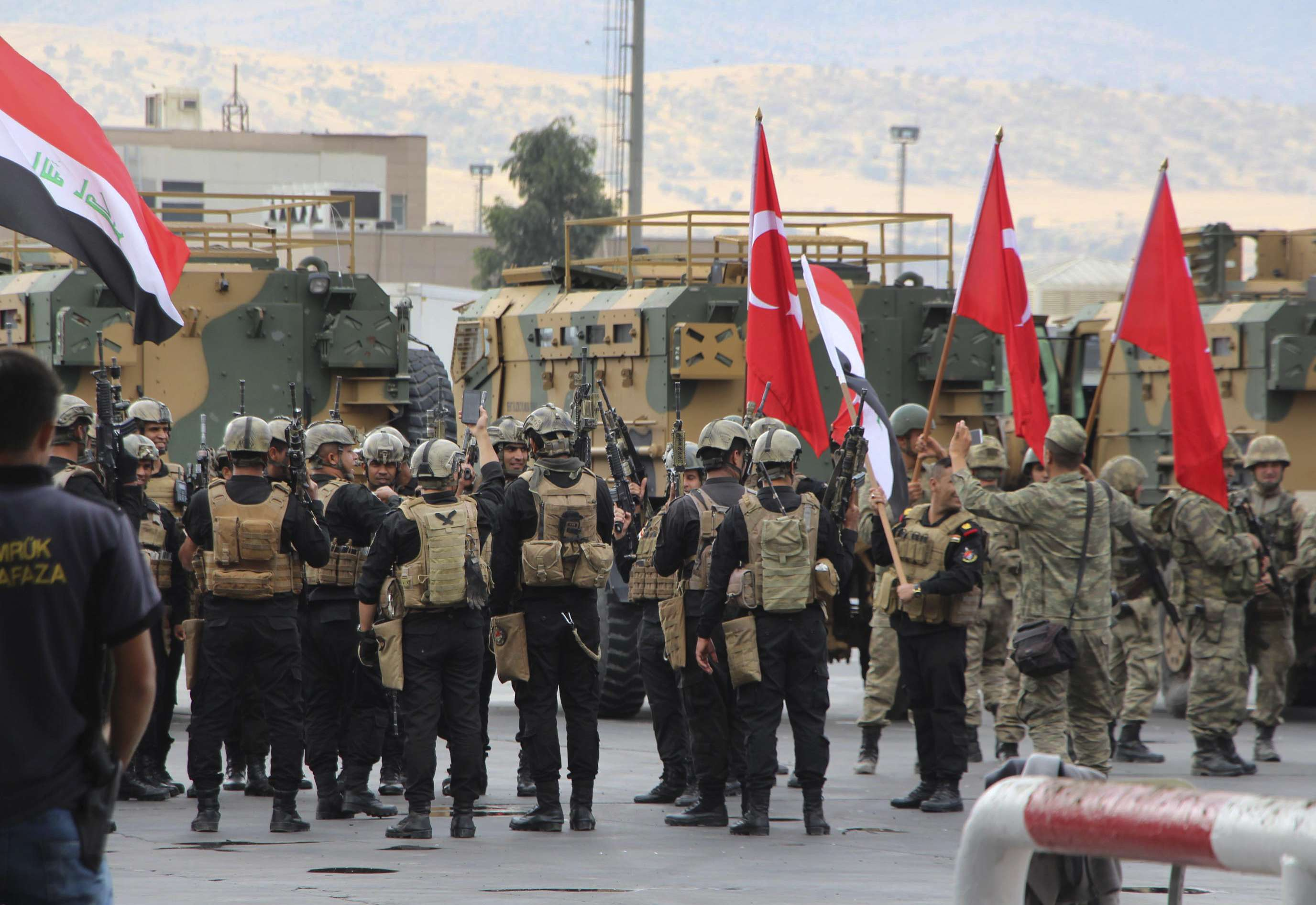Gathering steam. Turkish and Iraqi troops, some holding their national flags, participate in a ceremony at the Habur-Ibrahim Khalil border crossing with Iraq near Silopi in south-eastern Turkey, last October. (AP)