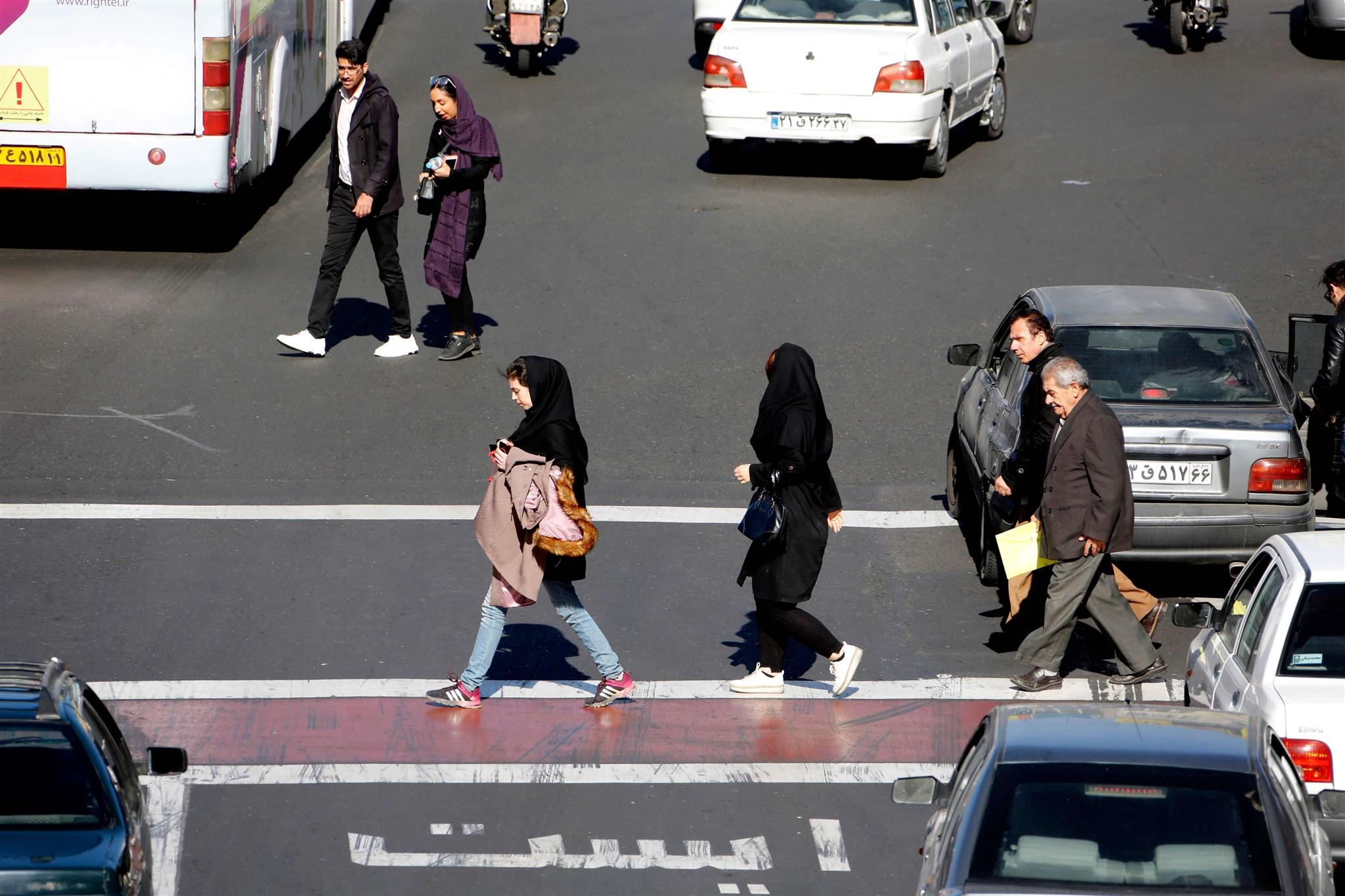 Iranians cross the road in Sadeqyeh Square in Tehran. (AFP)