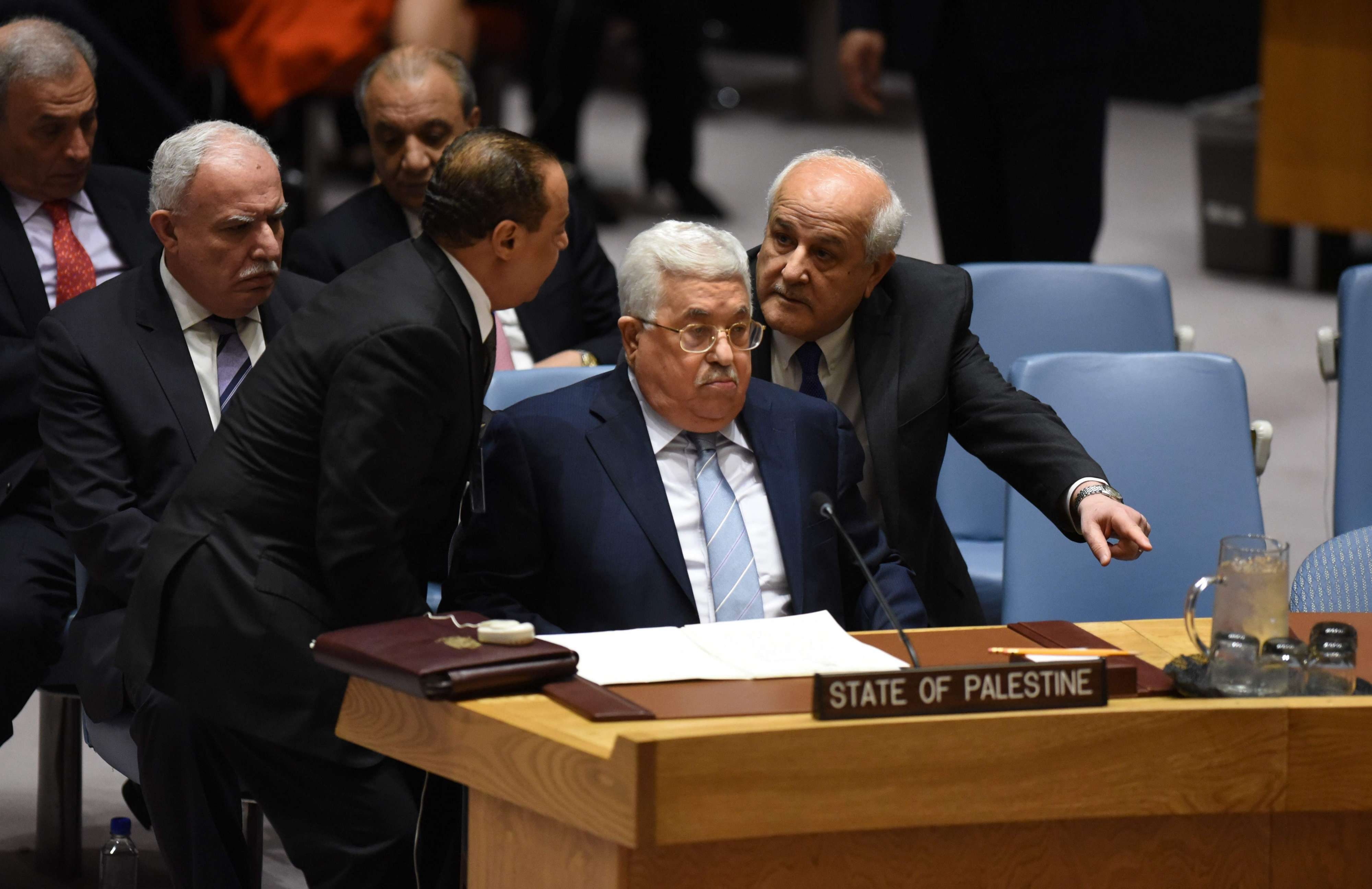 Palestinian leader Mahmud Abbas(C) attends the United Nations Security Council in New York, on February 20. (AFP)