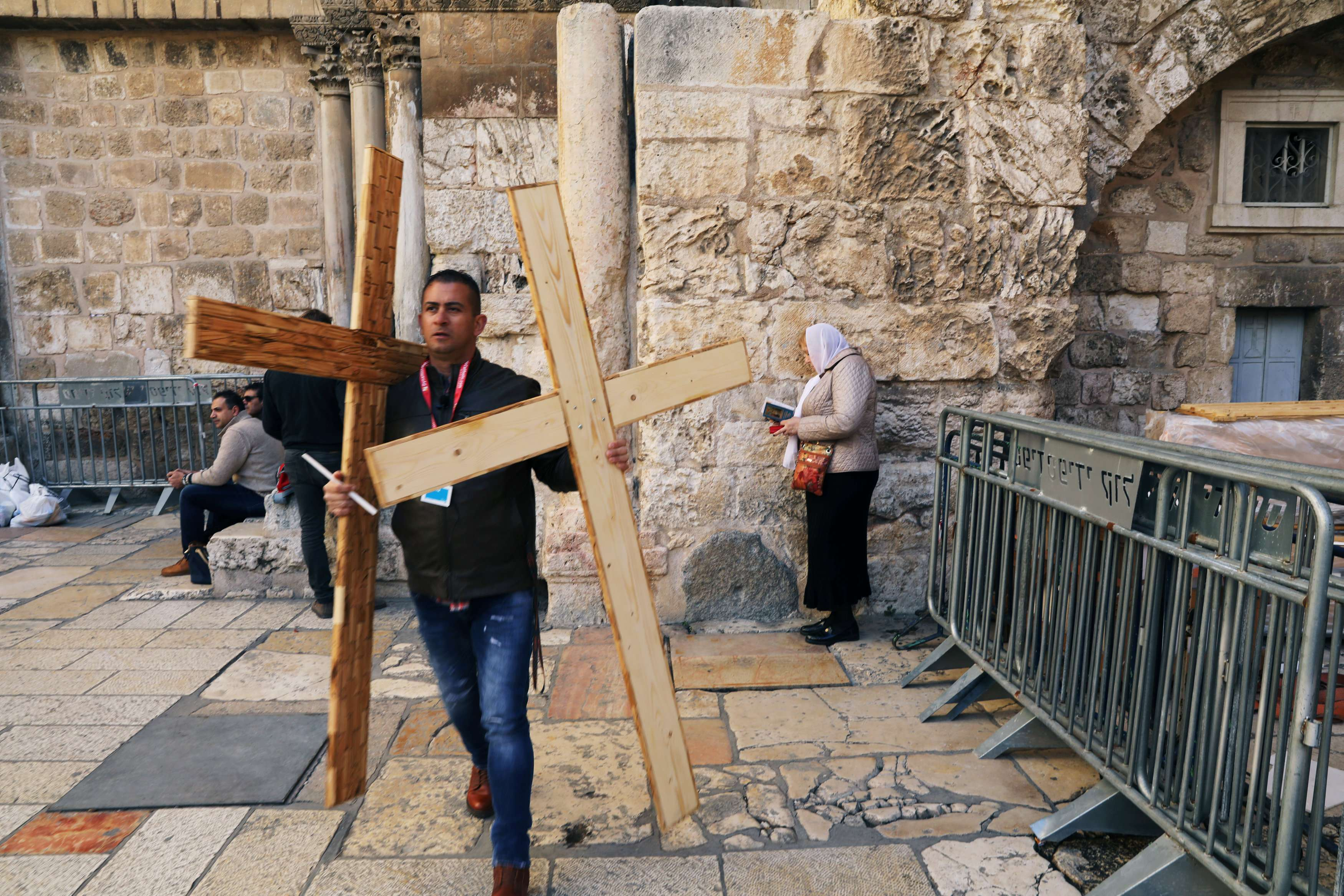 A man carries wooden crosses near the entrance to the Church of the Holy Sepulchre in Jerusalem's Old City, on February 28.  (Reuters)
