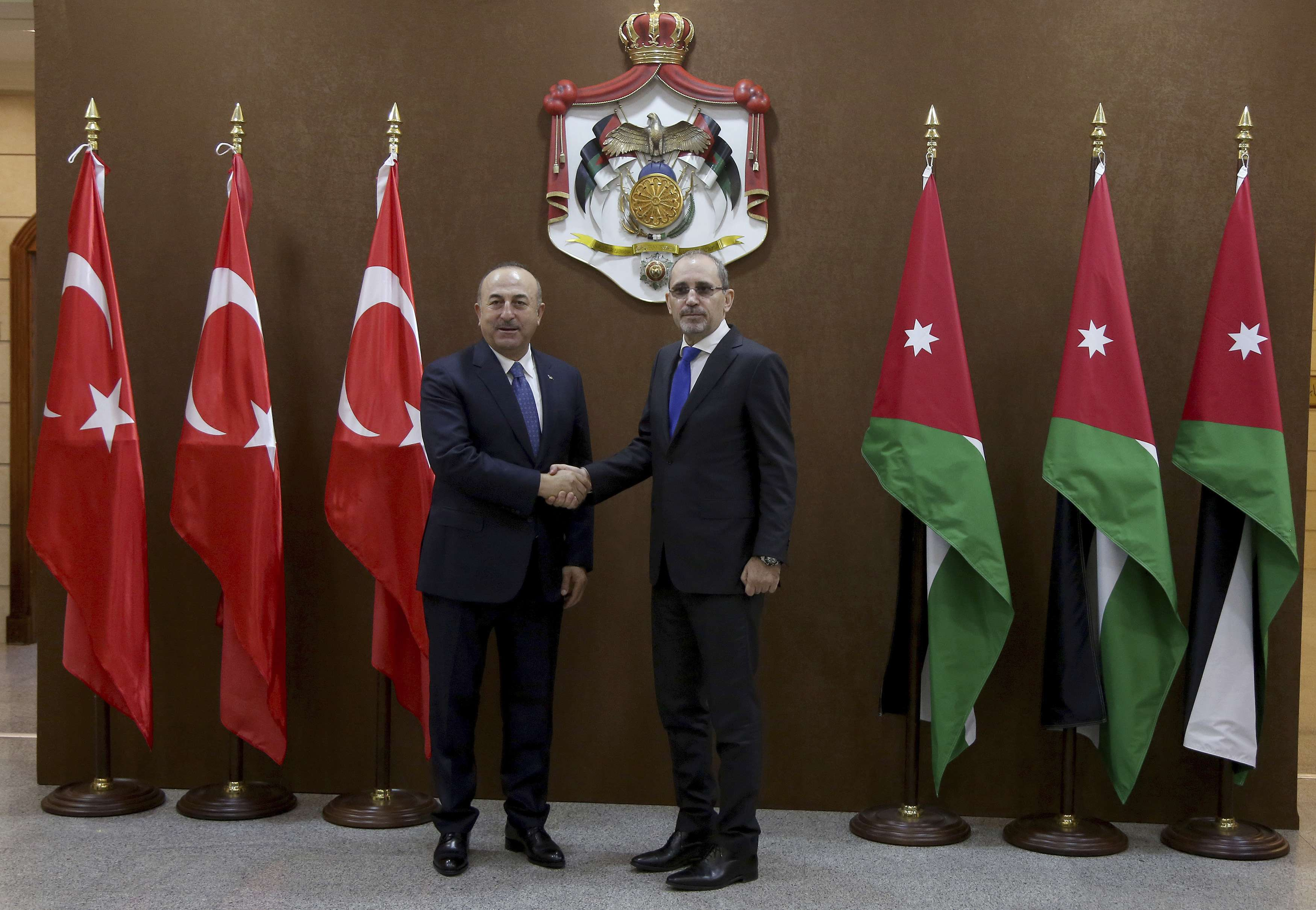 Turkish Foreign Minister Mevlut Cavusoglu (L) and Jordanian Foreign Minister Ayman Safadi meet in Amman, last month. (AP)