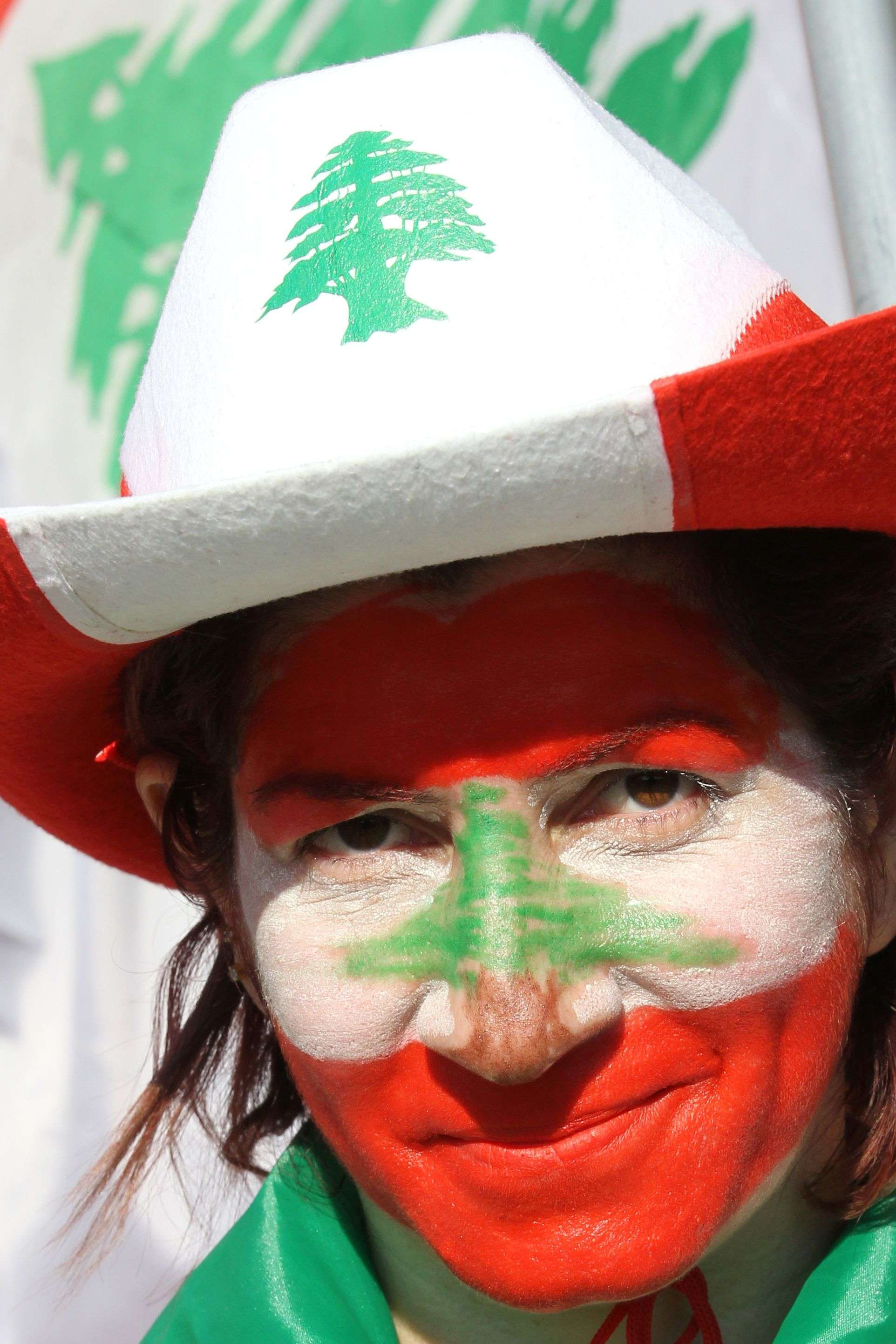 A supporter of Lebanon's President Michel Aoun with her face painted in the colours of the national flags attends a rally celebrating his election on November 6, 2016, at the presidential palace in Baabda. (AFP)