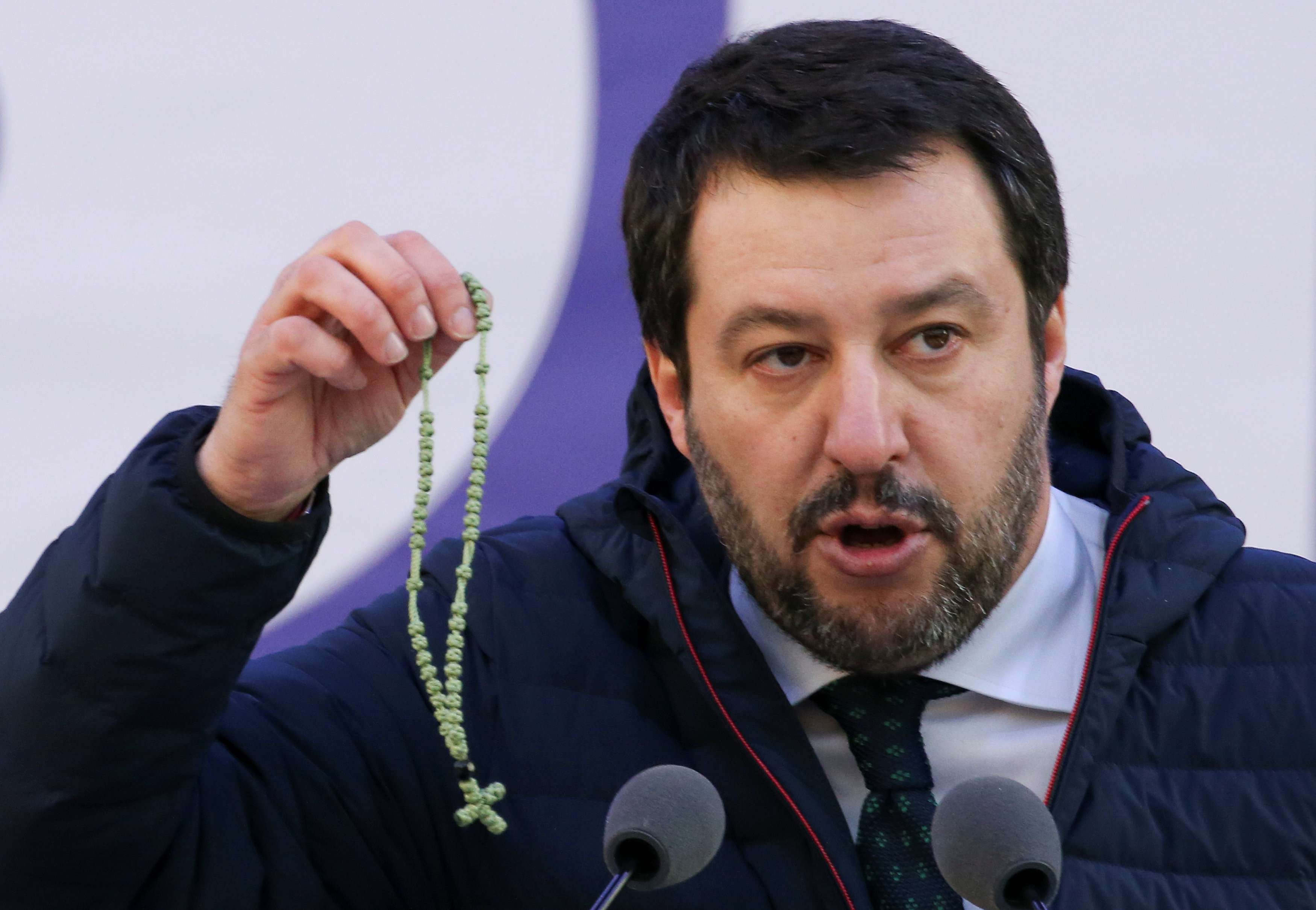 Italian Northern League leader Matteo Salvini shows a rosary as he speaks during a political rally in Milan, Italy February 24. (Reuters)