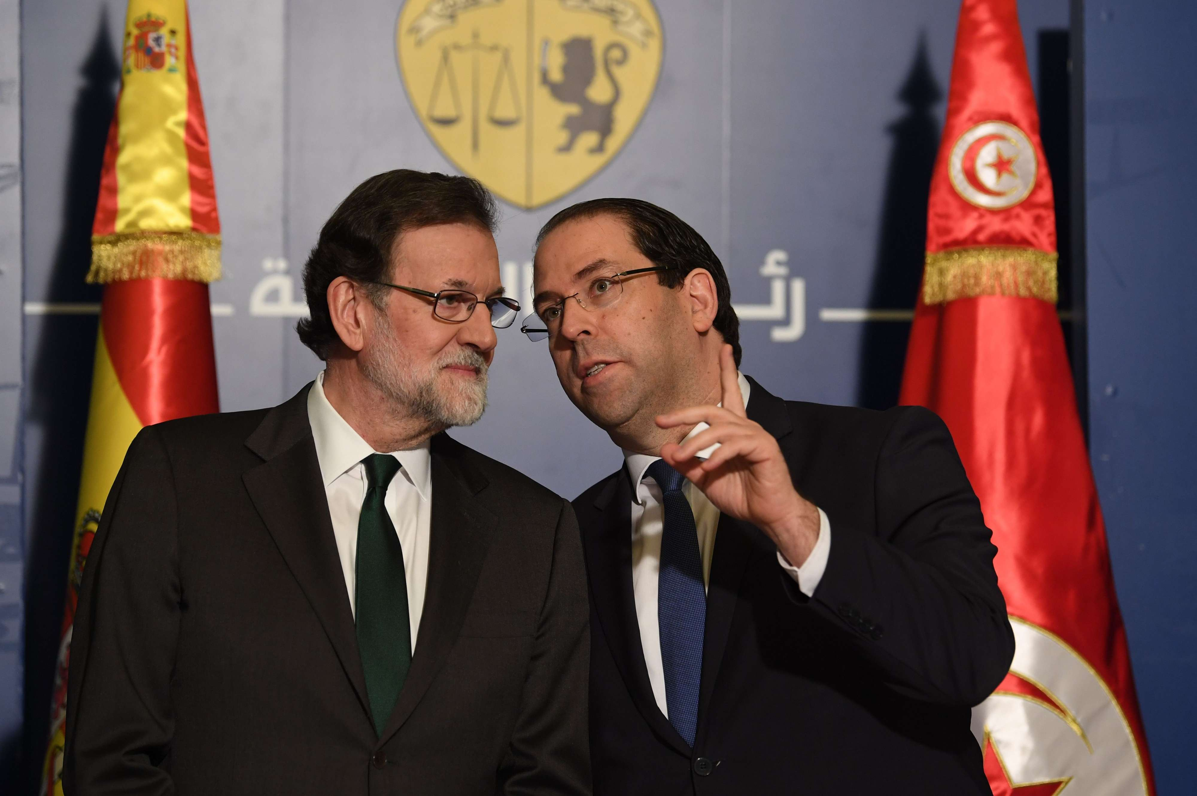 Spanish Prime Minister Mariano Rajoy (L) listens to his Tunisian counterpart Youssef Chahed after their meeting in Tunis, on February 26. (AFP)