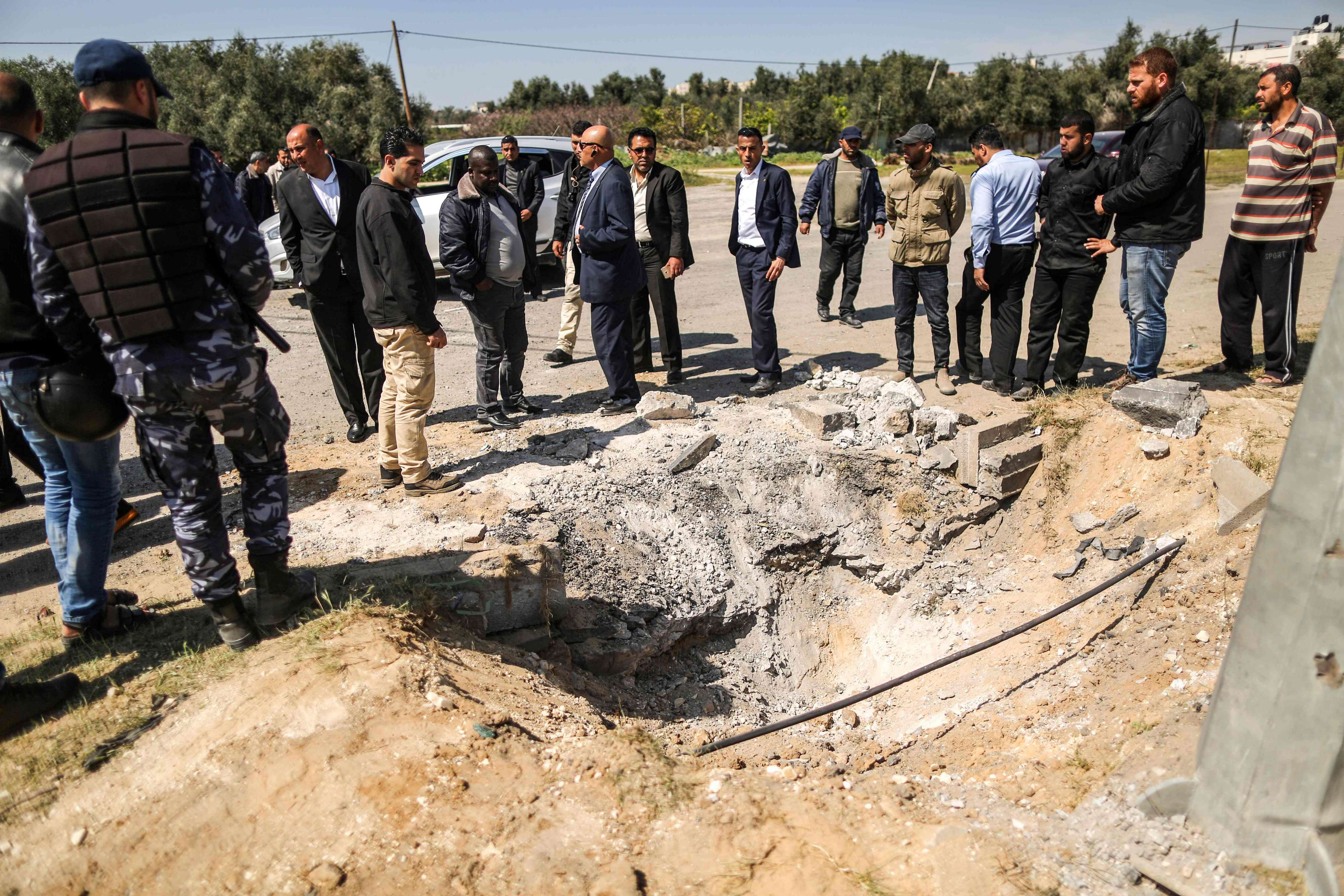 Members of the Hamas security forces inspect the crater at the site of an explosion that targeted the convoy of Palestinian Prime Minister Rami Hamdallah during his visit to the Gaza Strip, on March 13. (AFP)