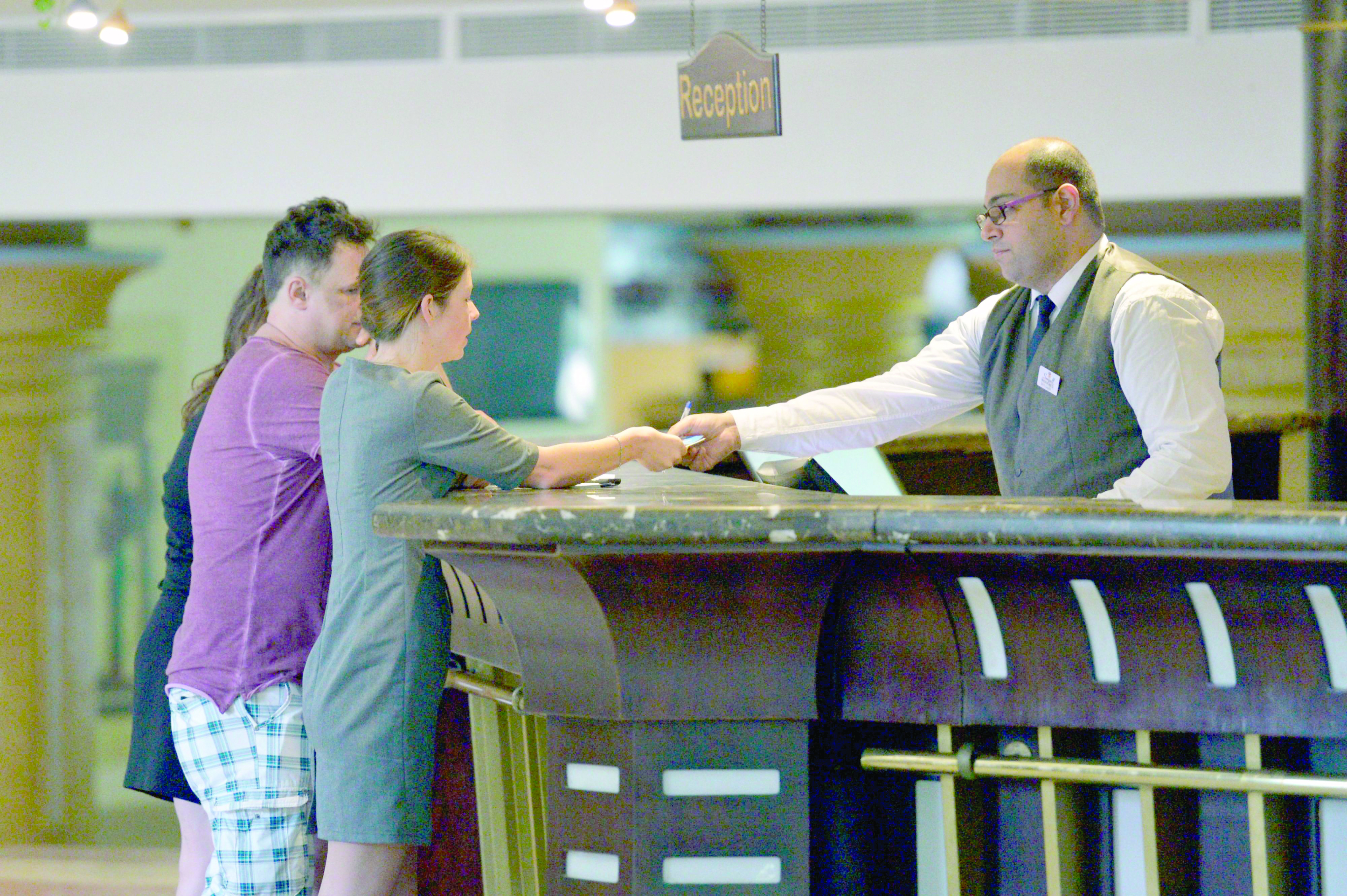 Tourists talk to a receptionist at a hotel in Egypt's Red Sea resort of Hurghada, on February 18. (AFP)