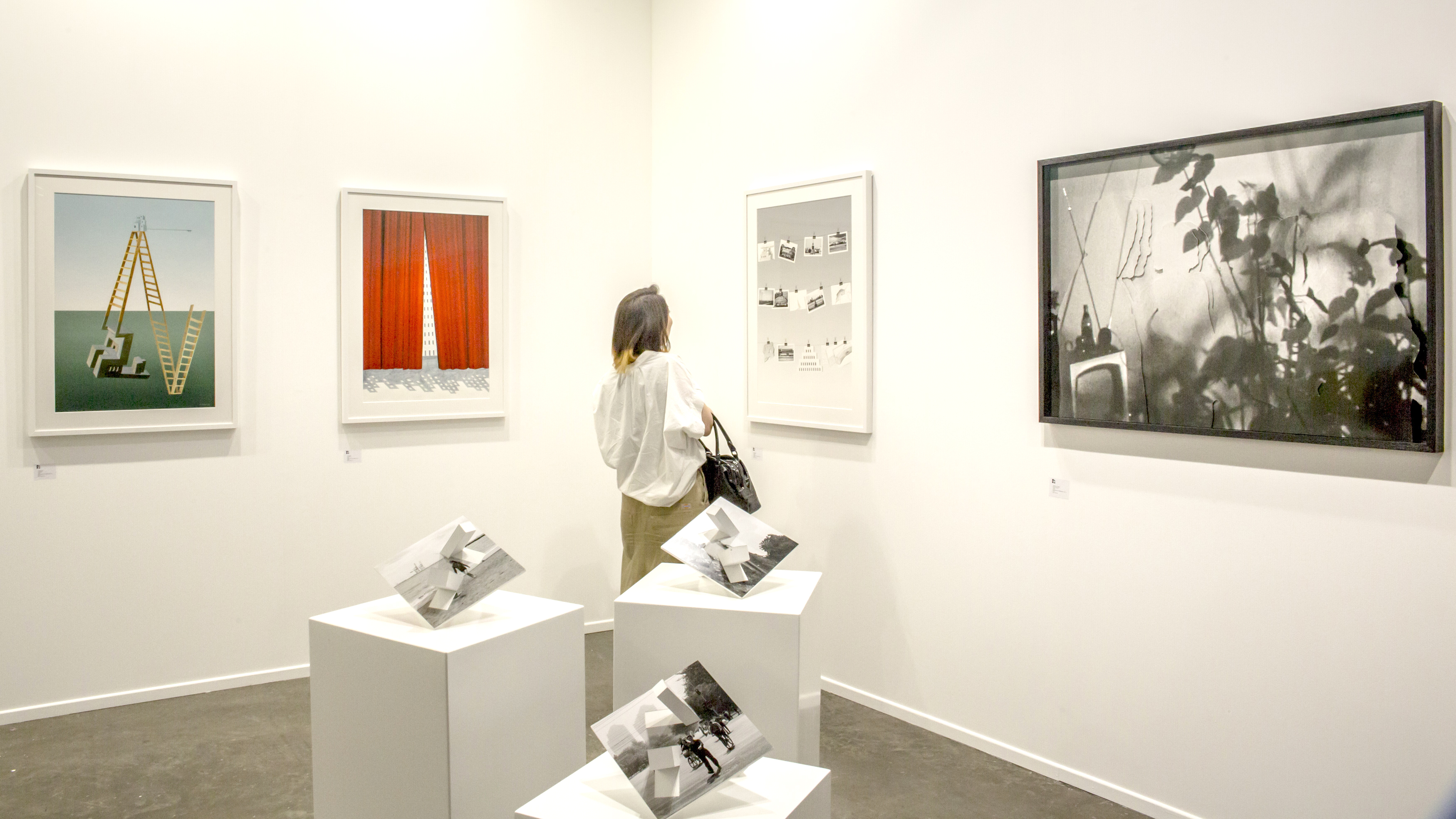 Globally diverse. A visitor checks  artwork at the Art Dubai Contemporary section.      (Photo Solutions)