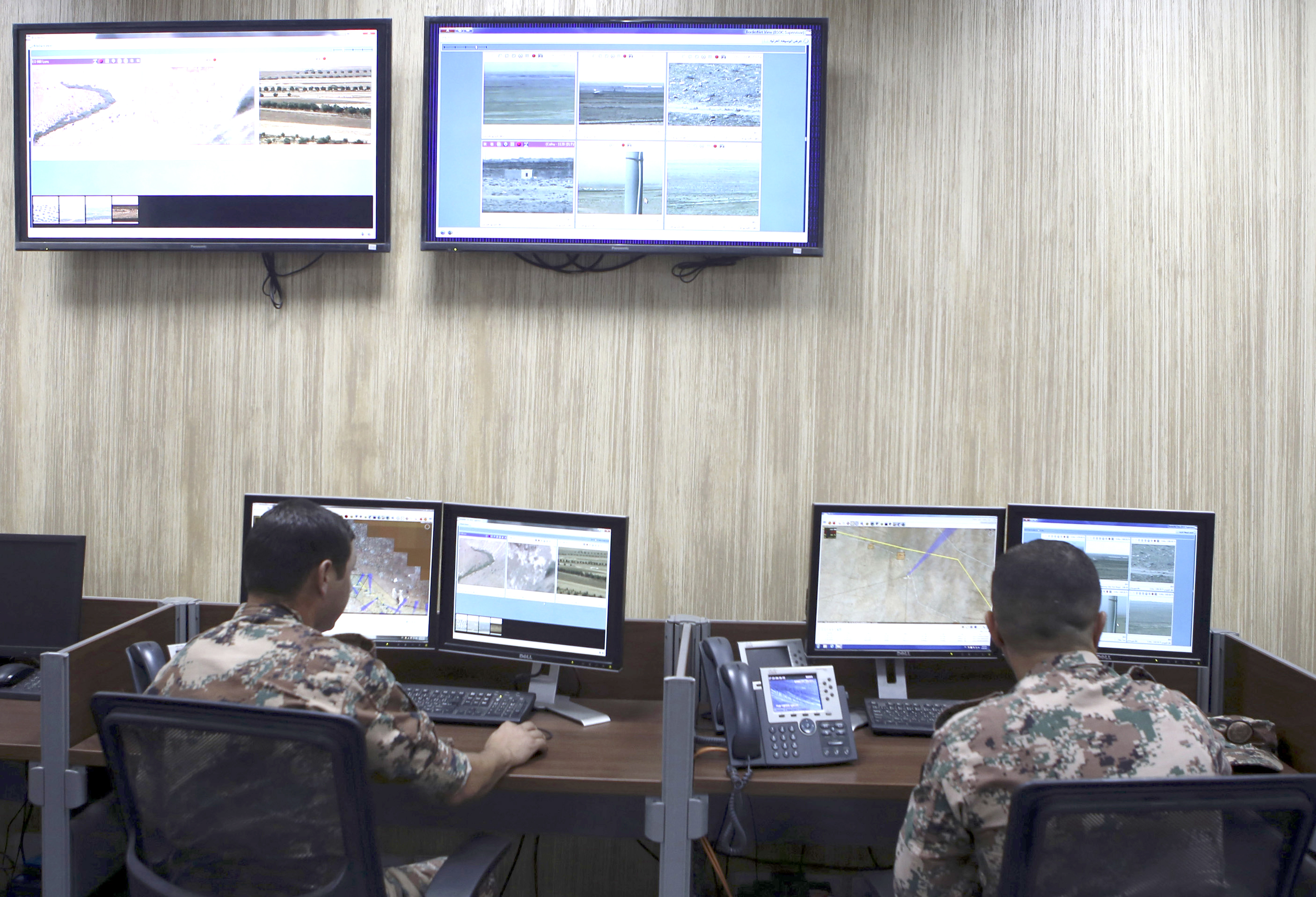 Jordanian soldiers watch computer screens. (AP)