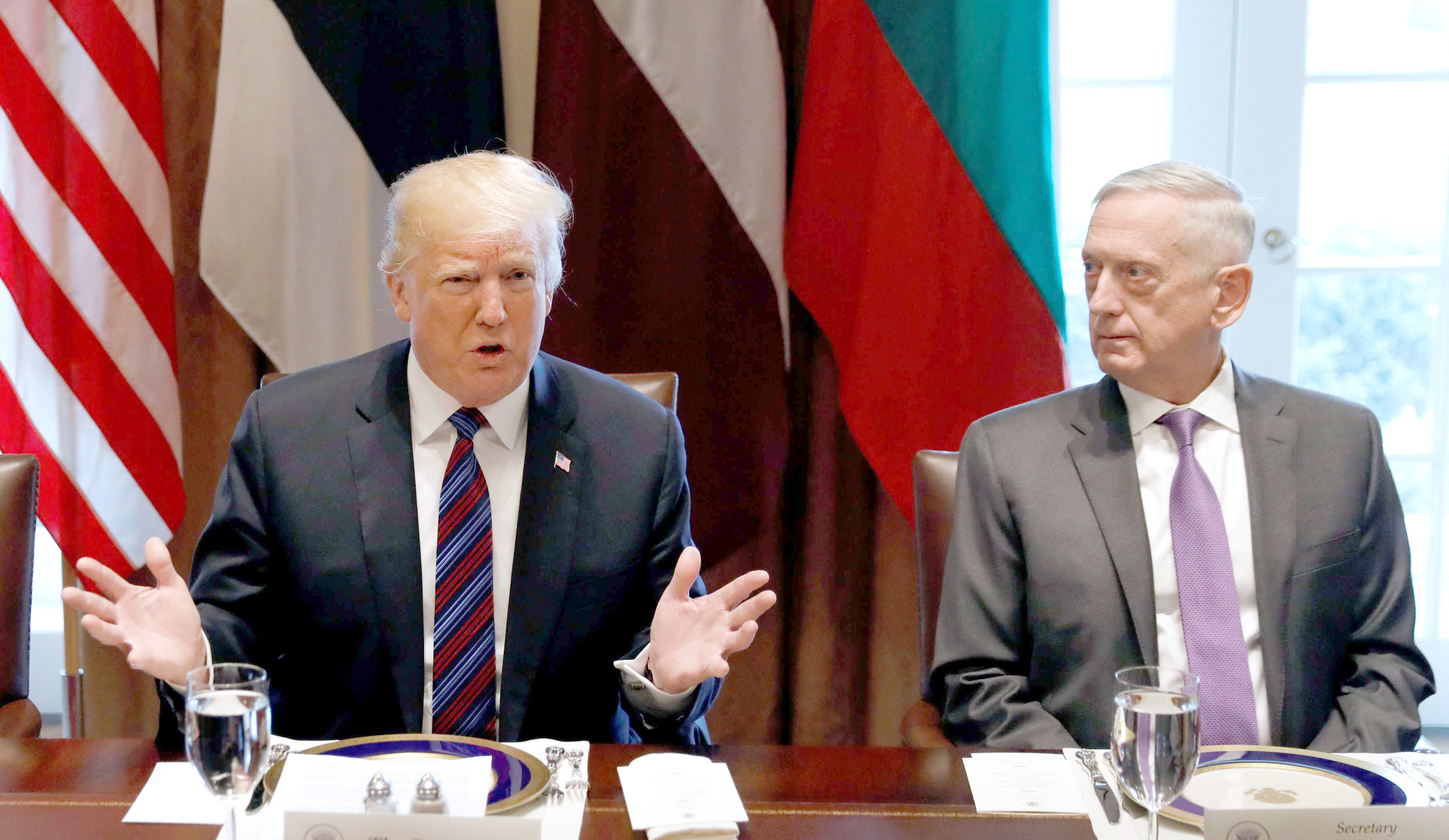 With US Secretary of Defence James Mattis (R) at his side, US President Donald Trump speaks at the White House, on April 3. (Reuters)